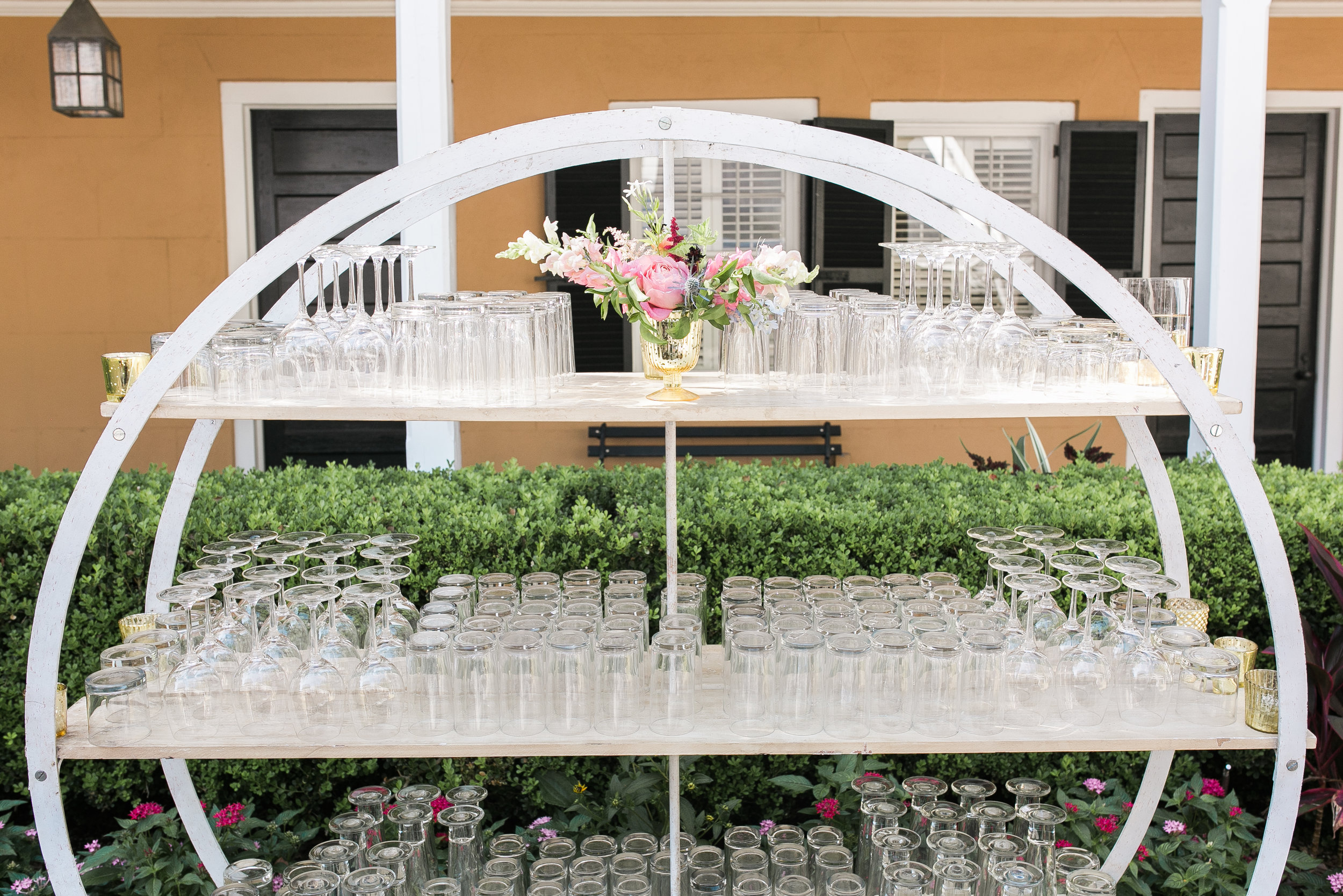 Circular bar setup by Cru Catering at outdoor Thomas Bennett House Reception  Colorful outdoor reception at The Thomas Bennett House wedding in Charleston, SC  //  photographed by Jenna Weddings  Traditional wedding ceremony at Cathedral of St. John the Baptist in Charleston, SC  //  A Lowcountry Wedding Magazine & Blog