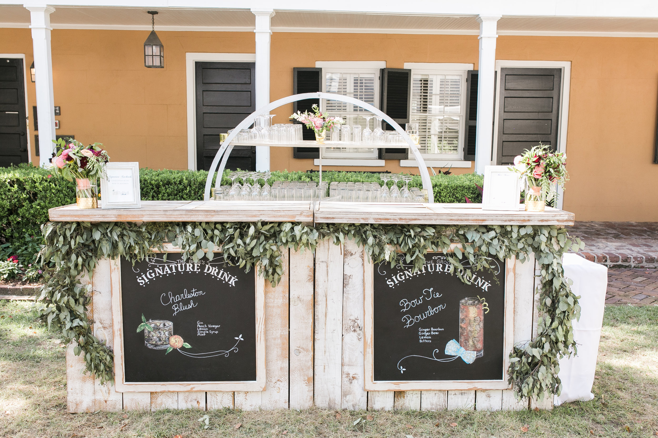 Custom bar with signature cocktail drink signs photographed by Jenna Marie Weddings  Colorful outdoor reception at The Thomas Bennett House wedding in Charleston, SC  //  photographed by Jenna Weddings  Traditional wedding ceremony at Cathedral of St. John the Baptist in Charleston, SC  //  A Lowcountry Wedding Magazine & Blog