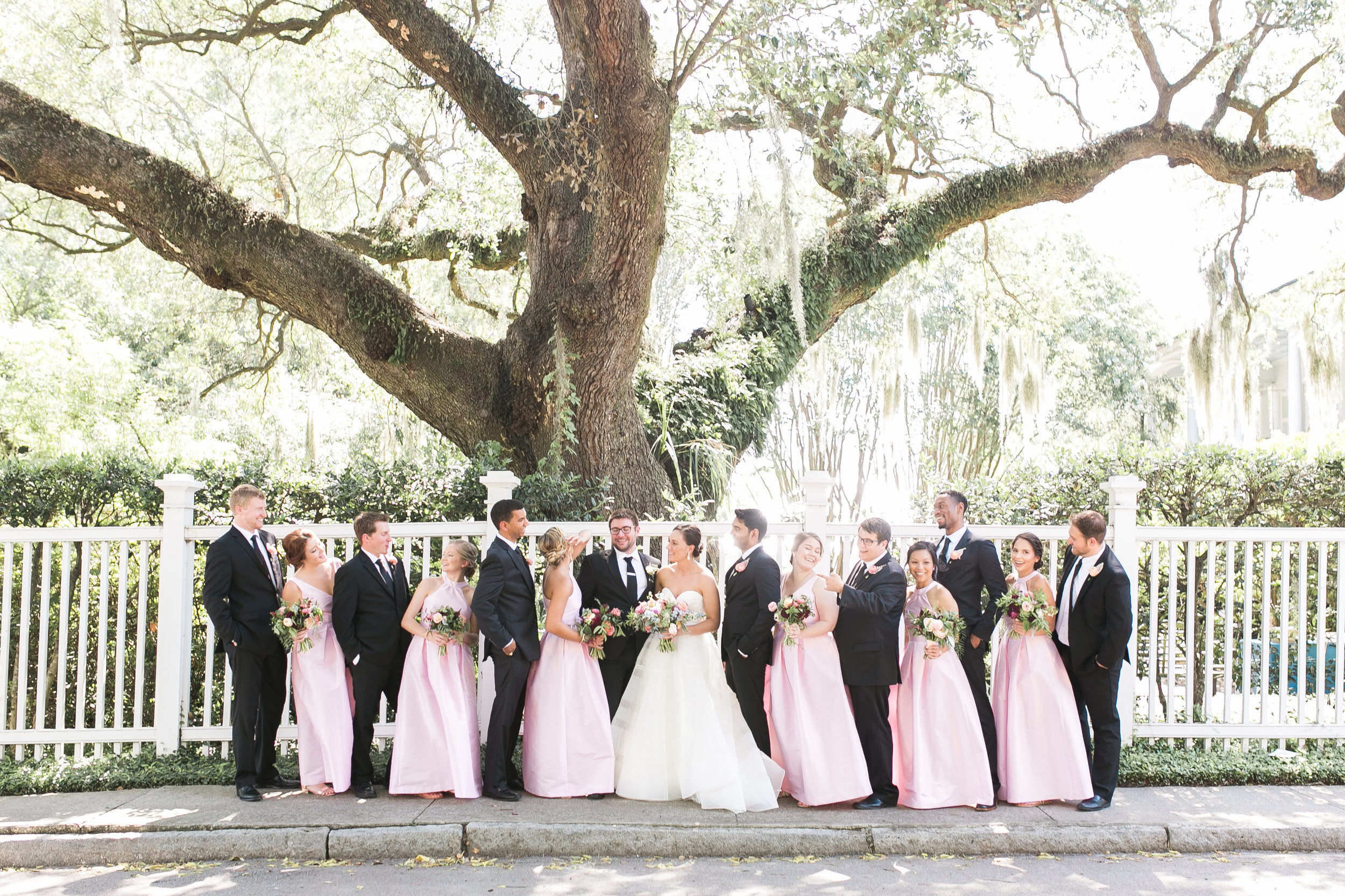 Phoebe & Derek's Thomas Bennett House wedding in Charleston, SC  Colorful outdoor reception at The Thomas Bennett House wedding in Charleston, SC  //  photographed by Jenna Weddings  Traditional wedding ceremony at Cathedral of St. John the Baptist in Charleston, SC  //  A Lowcountry Wedding Magazine & Blog