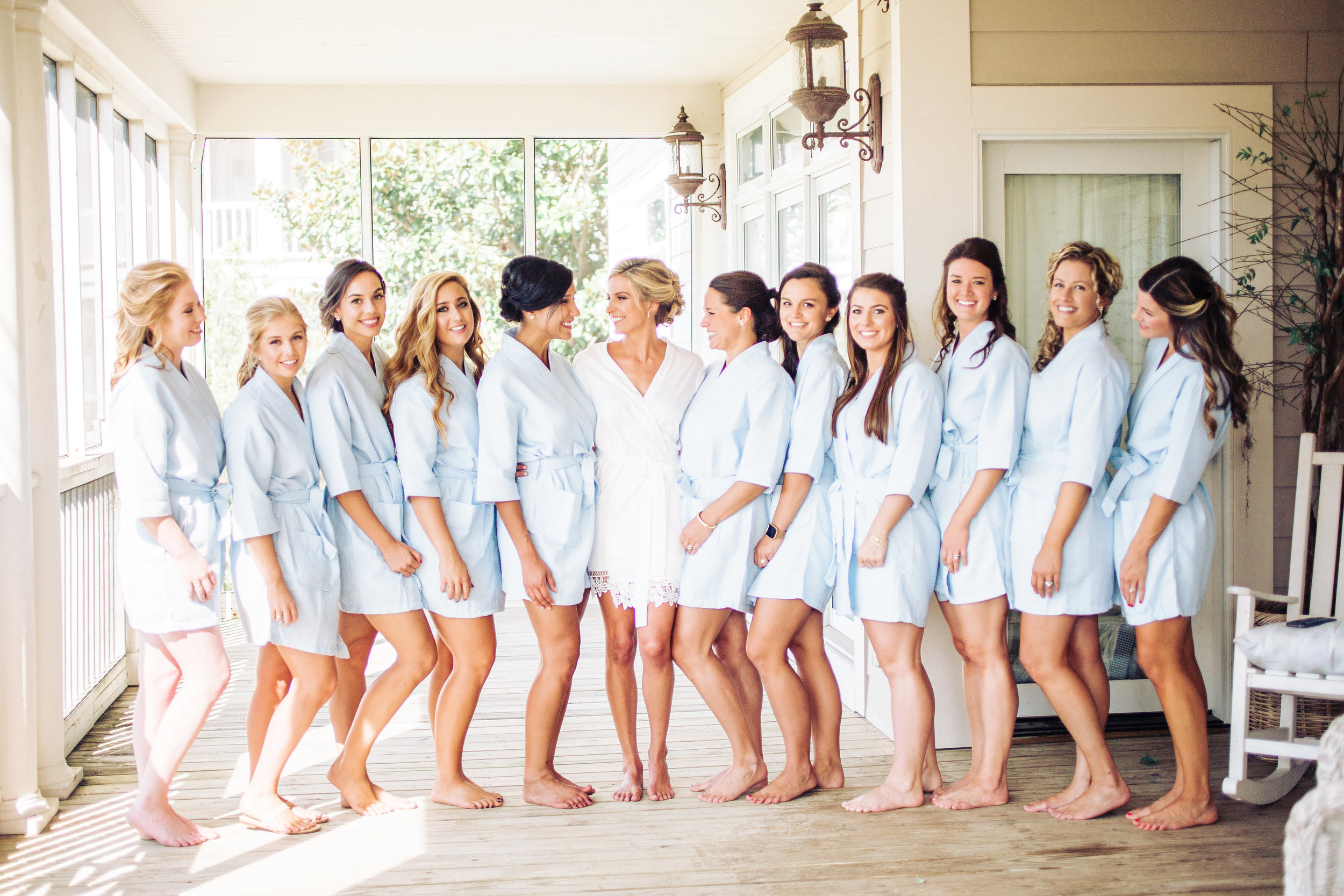 Bride with her bridesmaids in matching blue robes for a wedding at DeBordieu Club  //  A Lowcountry Wedding Magazine & Blog