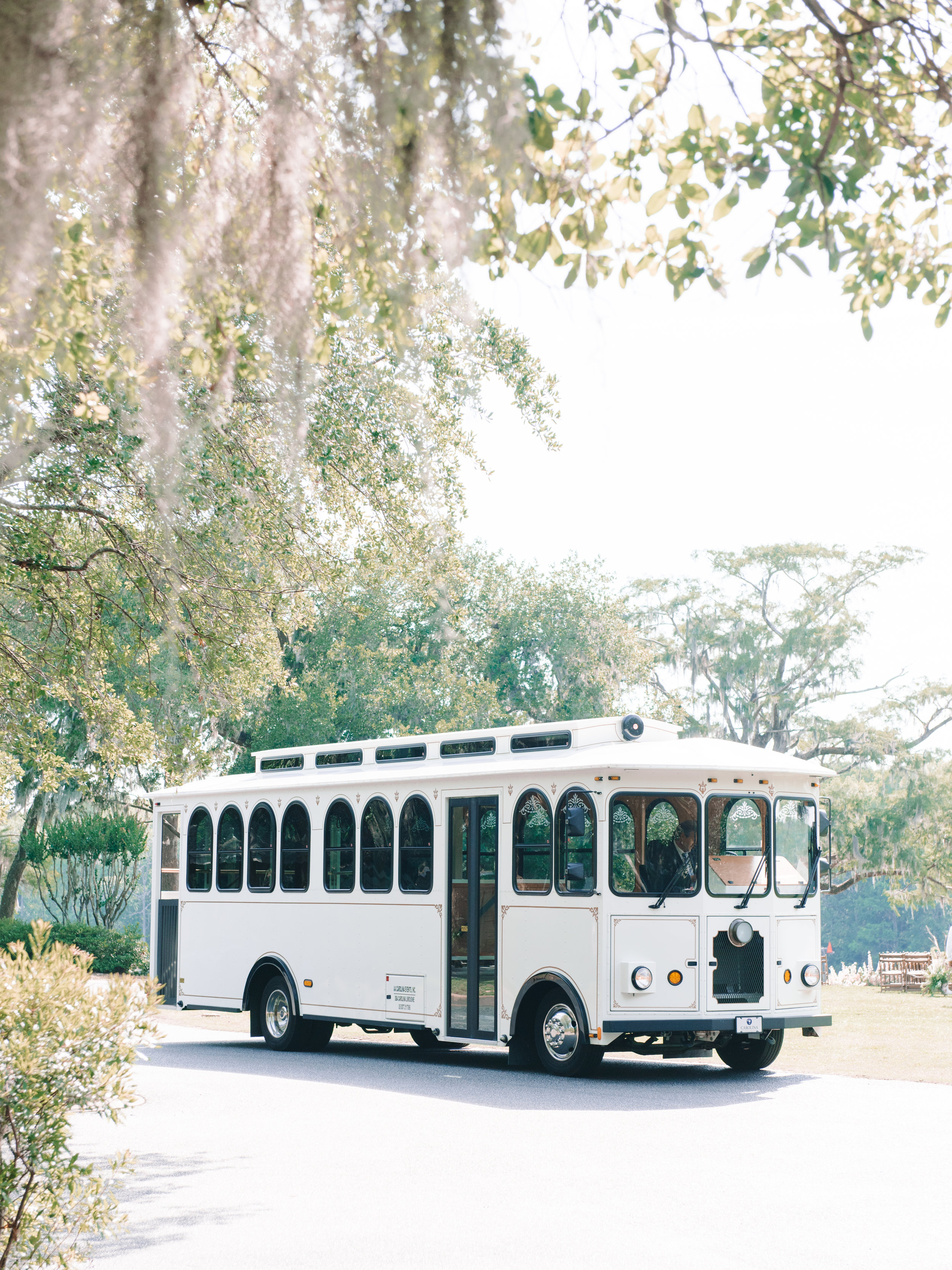 White trolley from Carolina Limousine at Wachesaw Plantation wedding  //  A Lowcountry Wedding Magazine & Blog