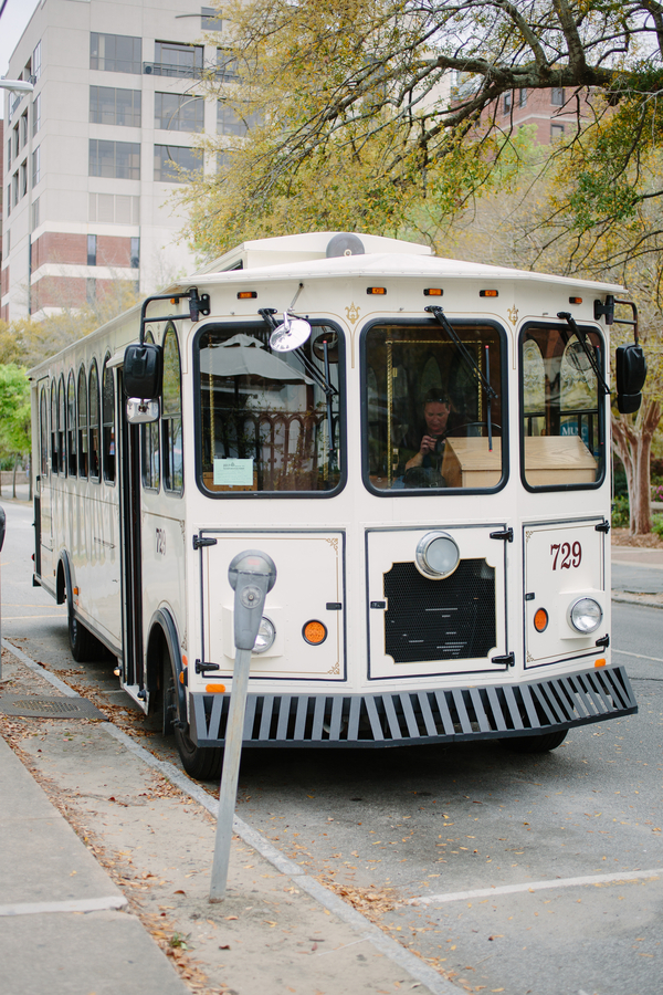 White trolley from Lowcountry Loop Trolley at Charleston SC wedding   // photos by Riverland Studios  //  A Lowcountry Wedding Magazine