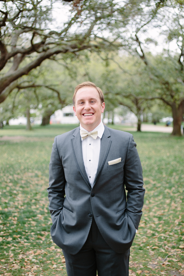 Groom wearing a grey suit and bow tie for Wickliffe House wedding   // photos by Riverland Studios  //  A Lowcountry Wedding Magazine