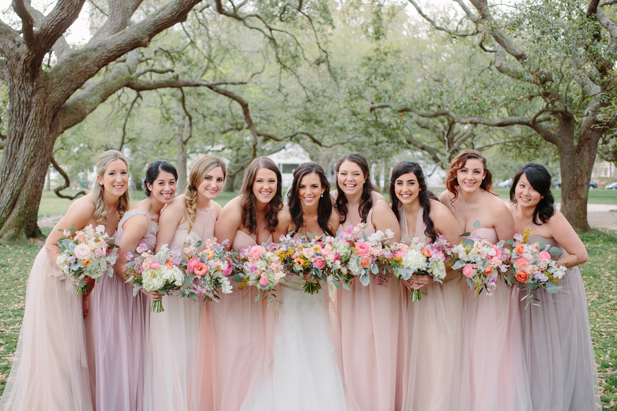 Bridesmaids wearing long pastel dresses for Wickliffe House wedding in Charleston SC