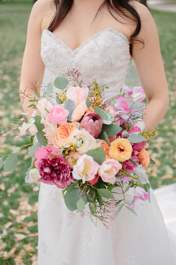 Spring bouquet of garden roses and tulips by Branch Design Studio  Three-tiered spring cake by Wildflour Pastry  //  Charleston wedding photography by Riverland Studios  //  A Lowcountry Wedding Magazine