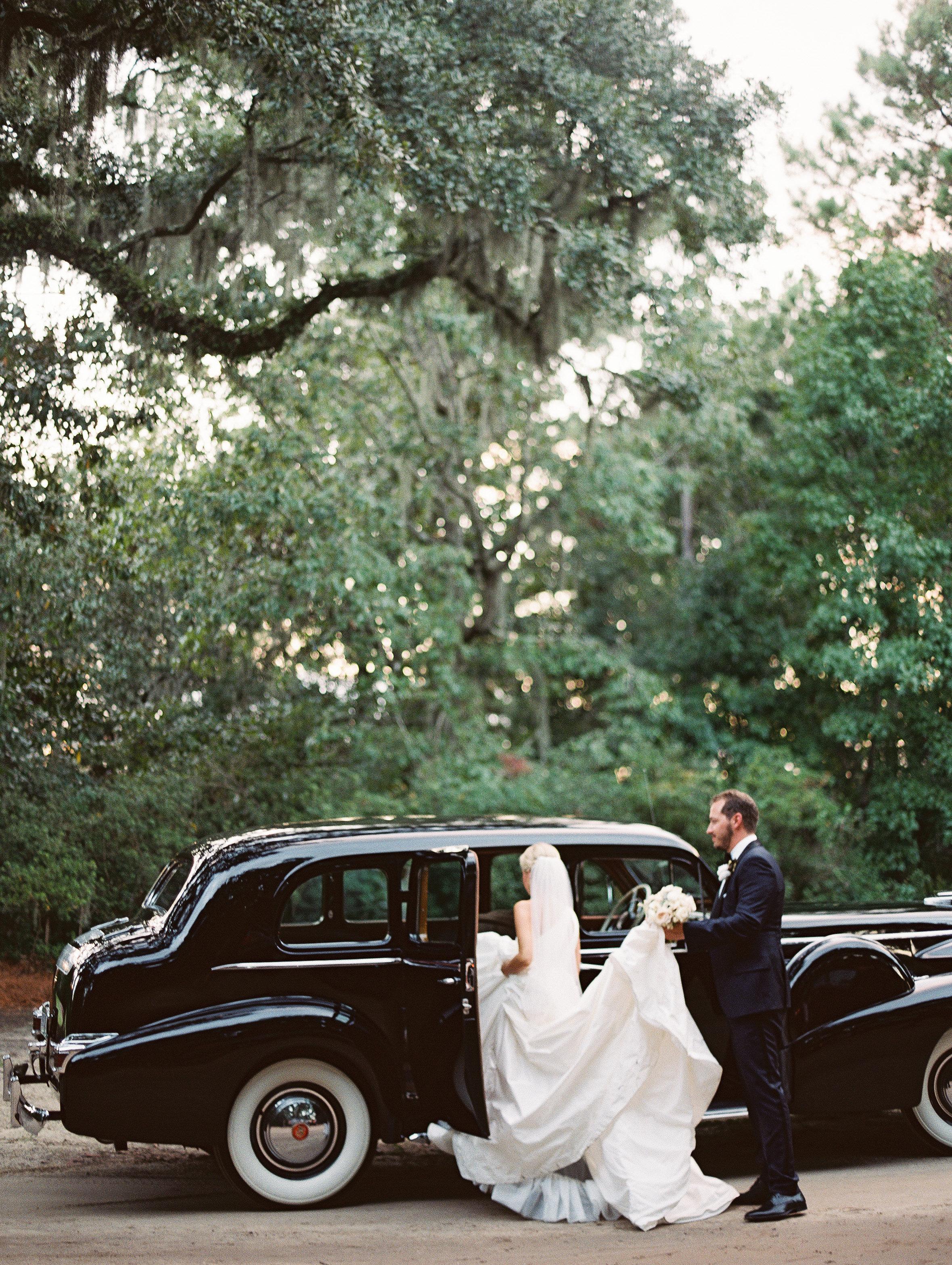 Vintage black Rolls Royce at wedding in Boone Hall Plantation  //  Wedding photography by Landon Jacob  //  A Lowcountry Wedding Magazine
