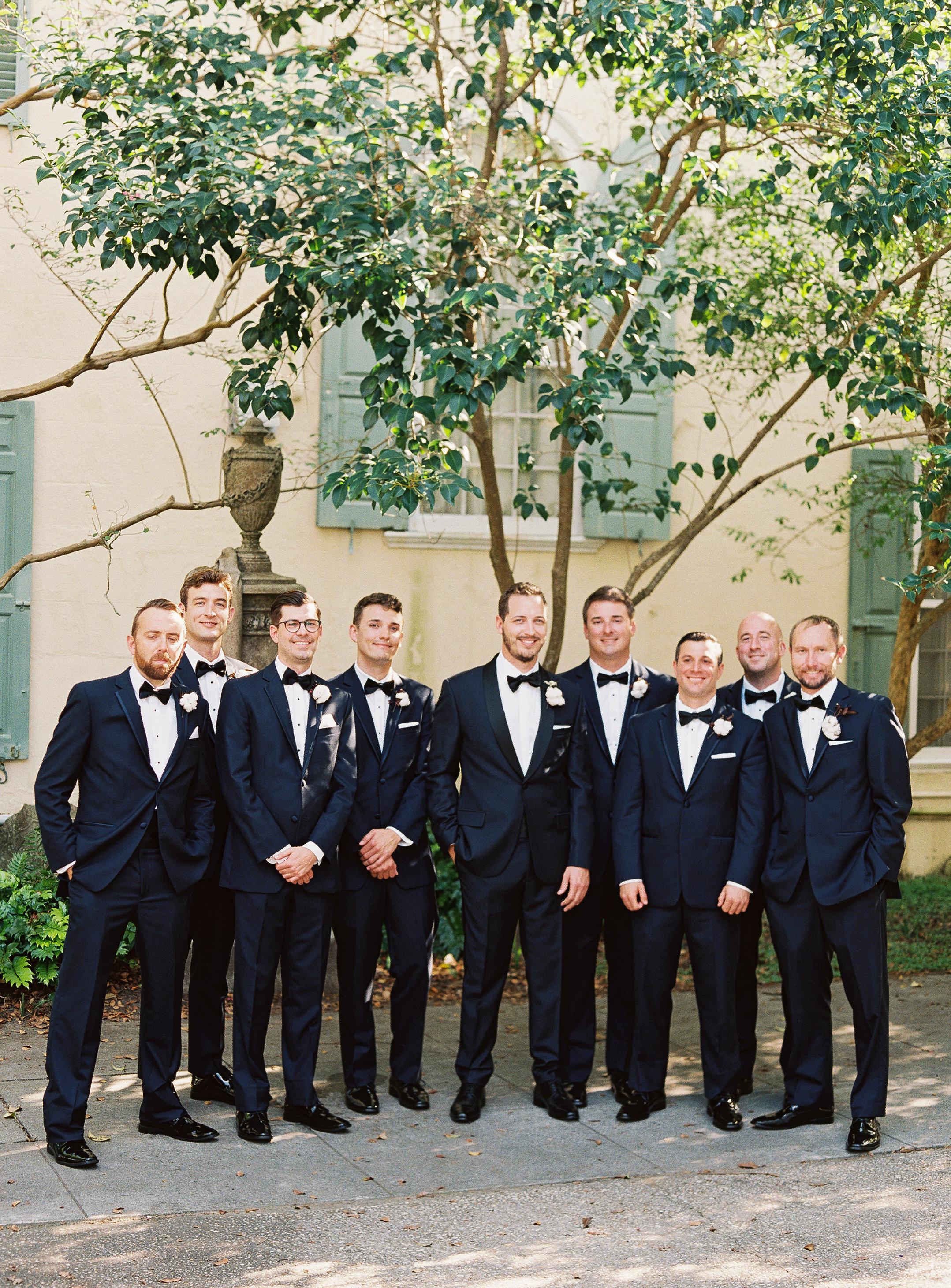 Groomsmen in navy tuxedos at wedding in Charleston SC  //  Wedding photography by Landon Jacob  //  A Lowcountry Wedding Magazine