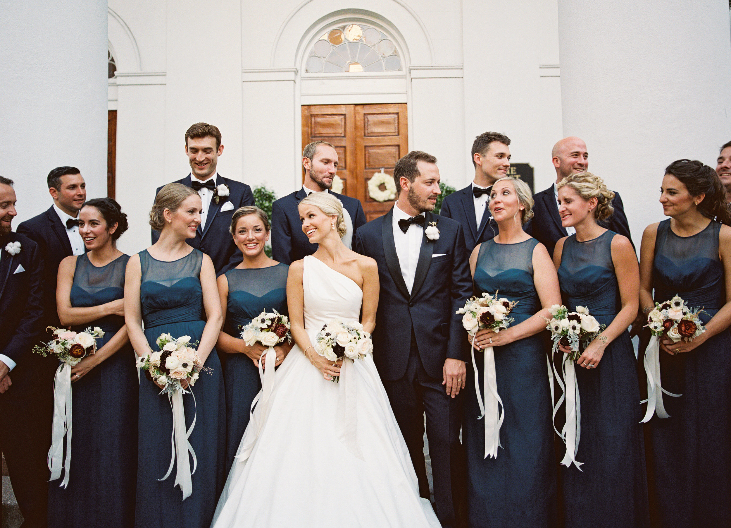 Bridesmaids in ocean teal dress and groomsmen in navy tuxedos at Charleston SC wedding  //  Wedding photography by Landon Jacob  //  A Lowcountry Wedding Magazine
