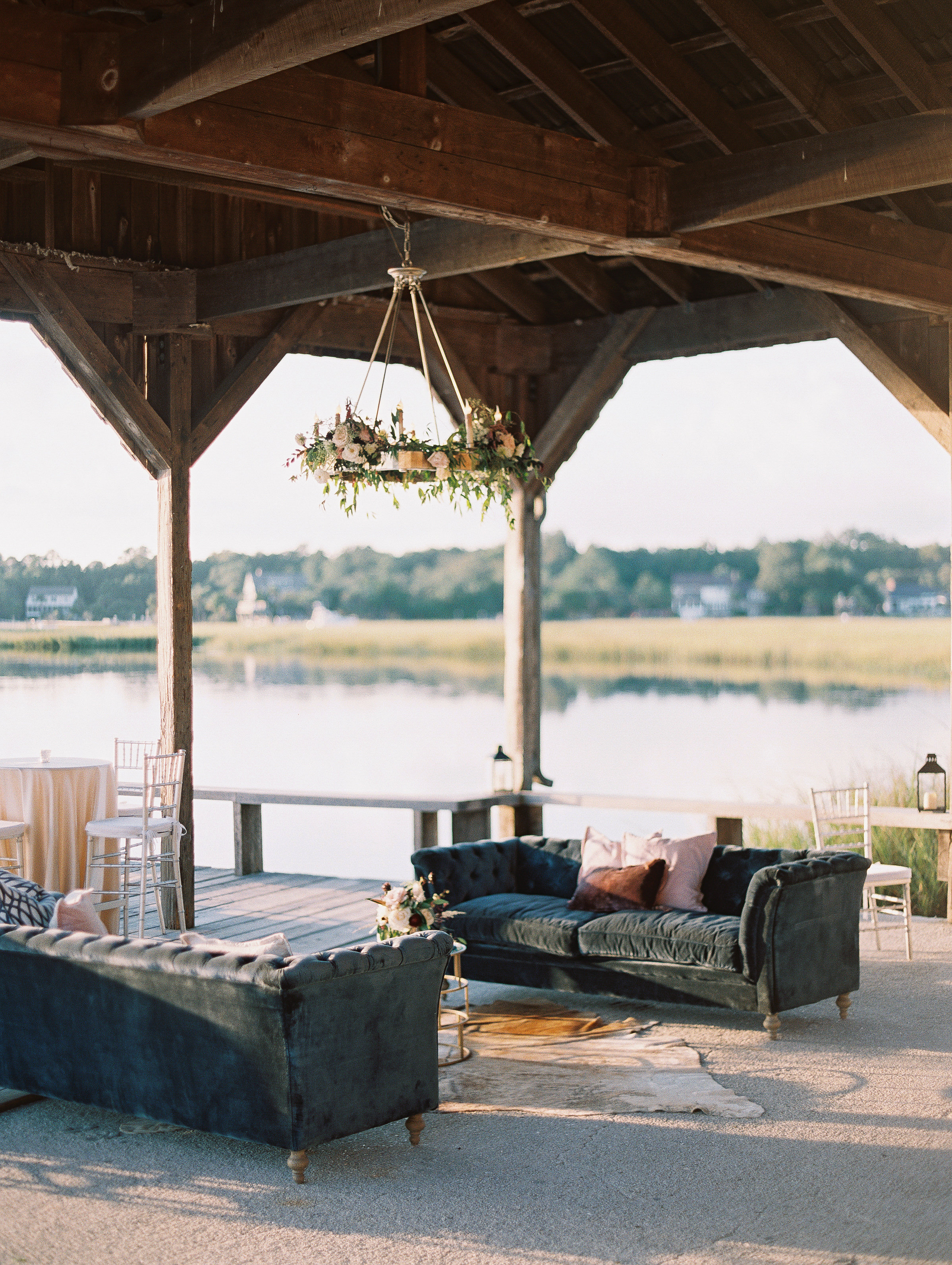 Navy lounge furniture on The Cotton Dock  //  Wedding photography by Landon Jacob  //  A Lowcountry Wedding Magazine