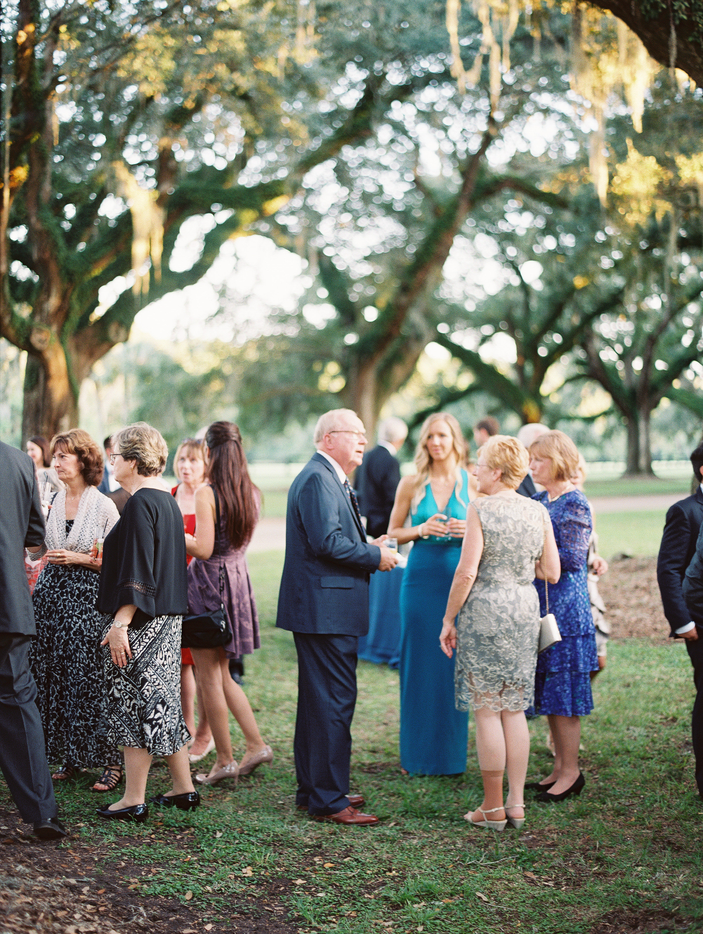 Cocktail hour at Boone Hall Plantation  //  Wedding photography by Landon Jacob  //  A Lowcountry Wedding Magazine