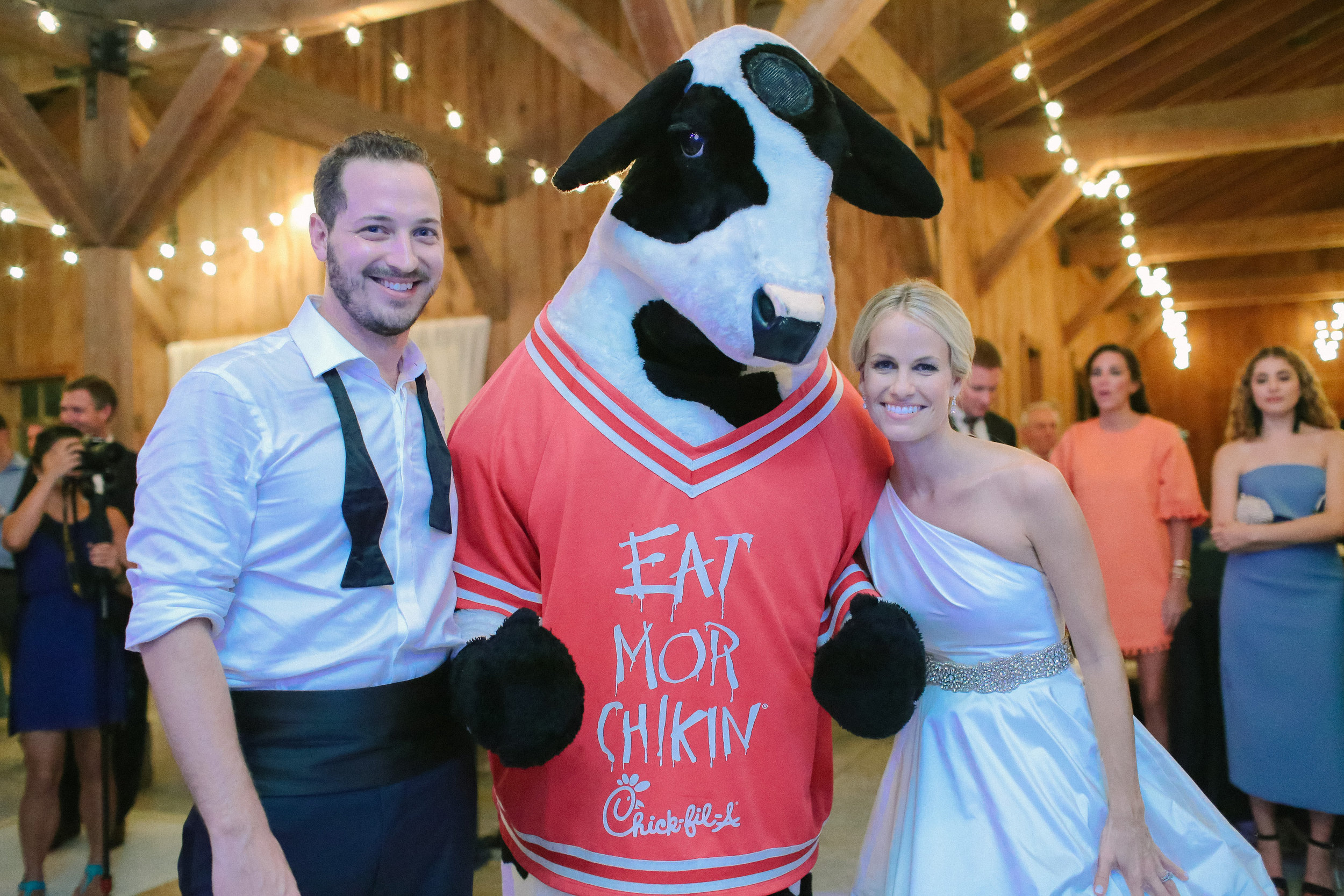 Chick-fil-A cow mascot at Boone Hall wedding reception  //  photographed by Landon Jacob  //  A Lowcountry Wedding Magazine