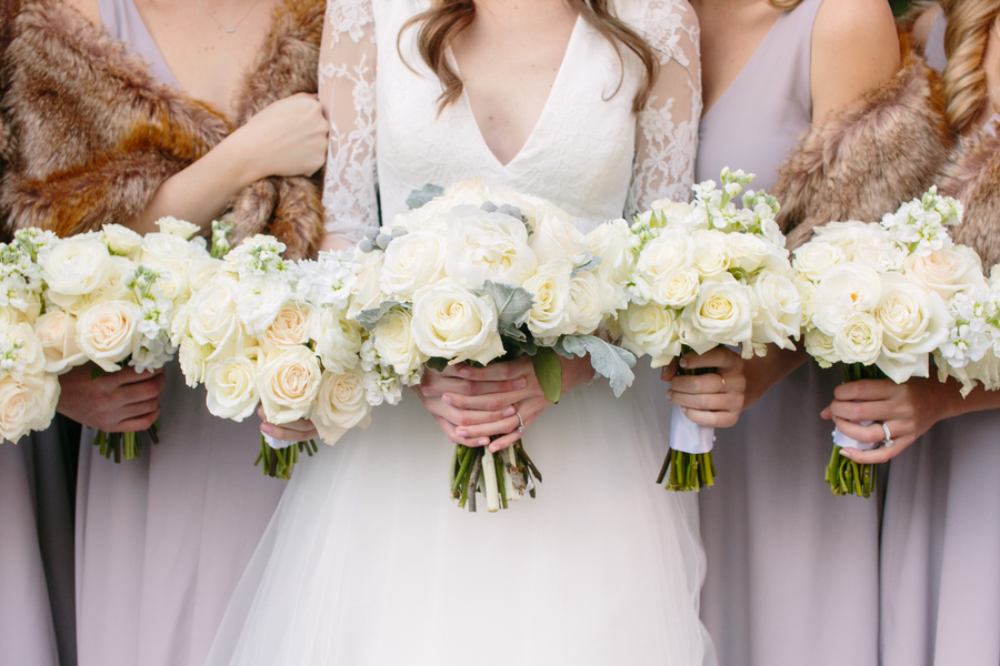 All white bridal bouquets at winter wedding in Charleston SC  //  A Lowcountry Wedding Magazine