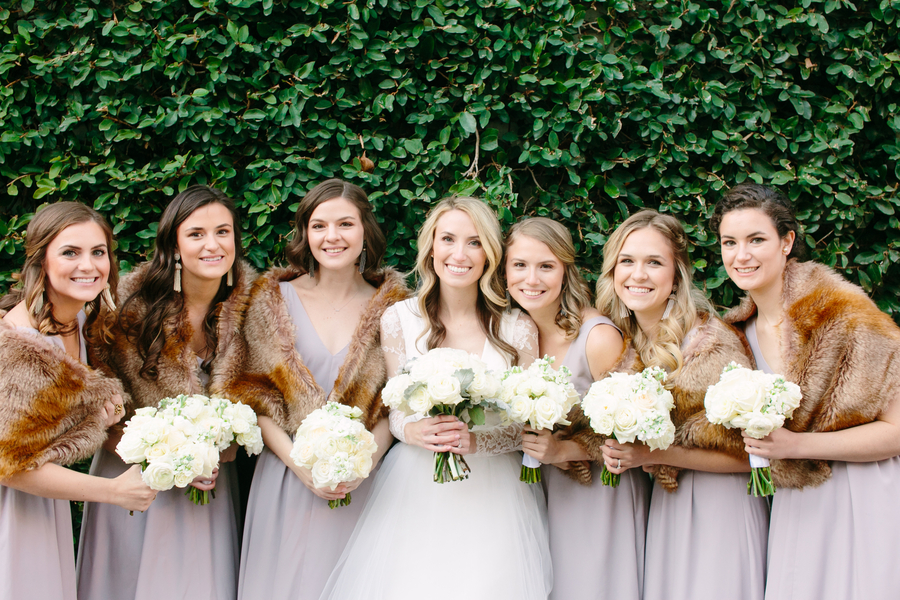 Bridesmaids in long neutral dresses with fur shawls at wedding in Charleston SC  Winter wedding at French Hugenot Church in Charleston, SC  //  A Lowcountry Wedding Magazine