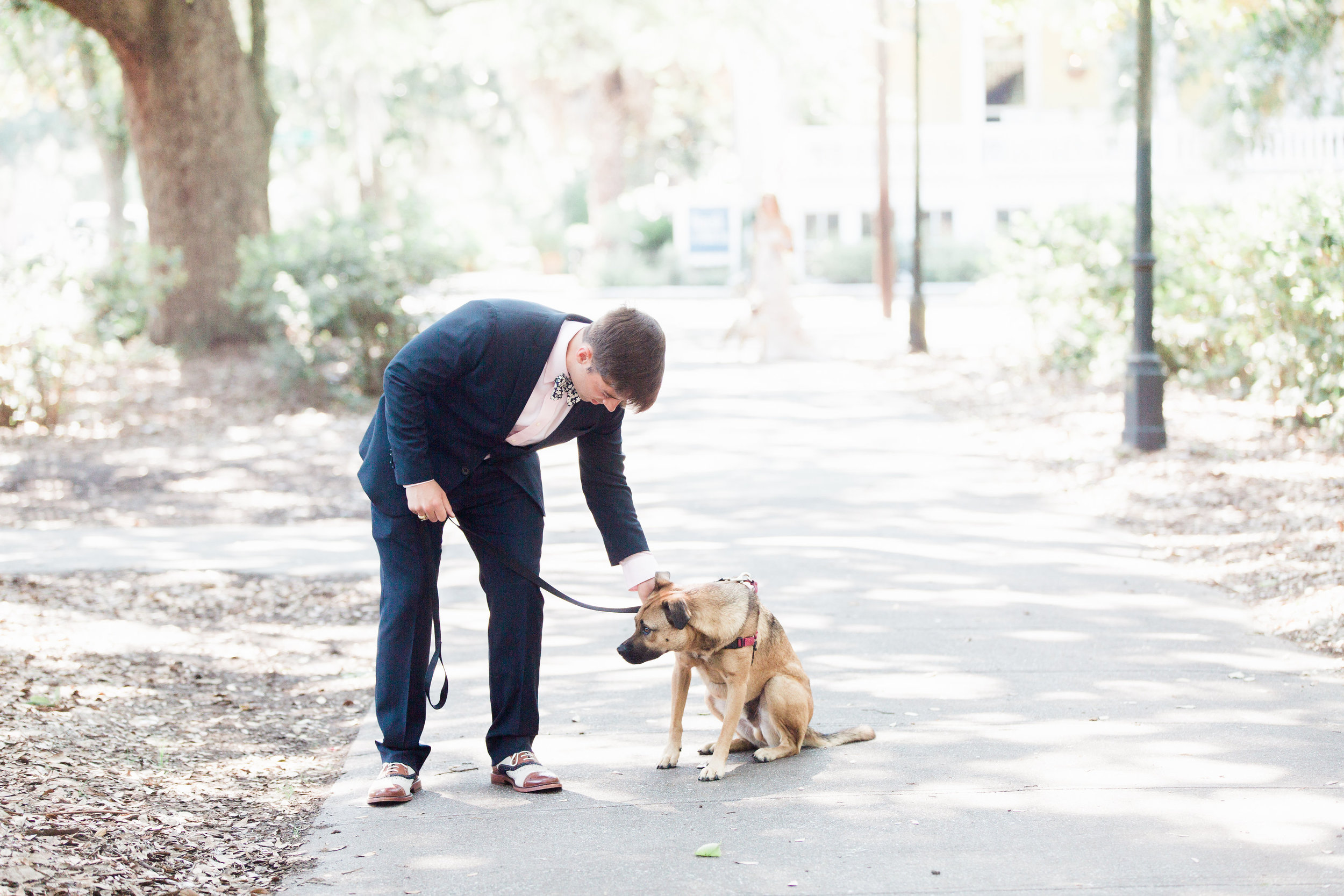 Groom and his dog preparing for First Look in Forsyth Park  //  Savannah wedding photos by Apt B Photography