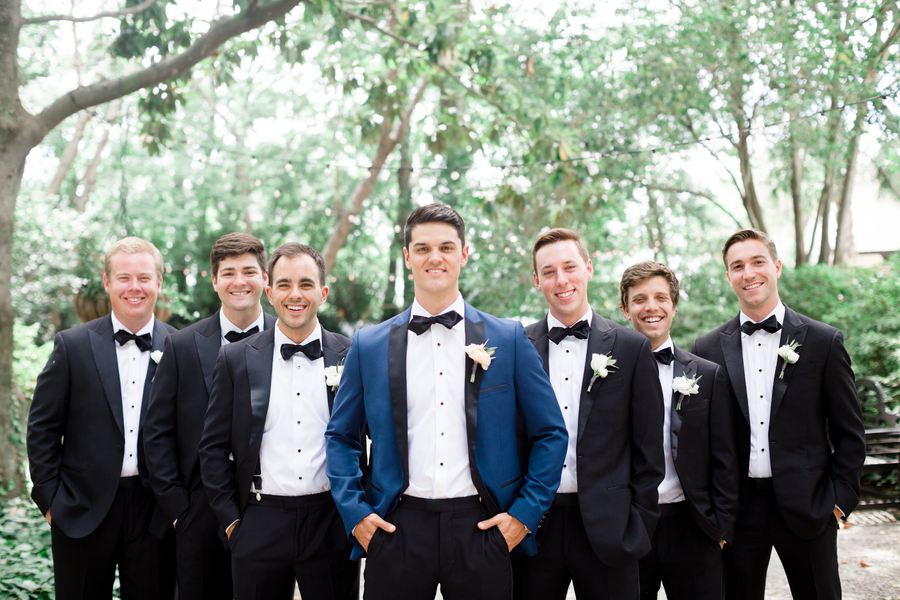Groom in navy tuxedo with his groomsmen at The Thomas Bennett House //  Charleston wedding photography by JoPhotos