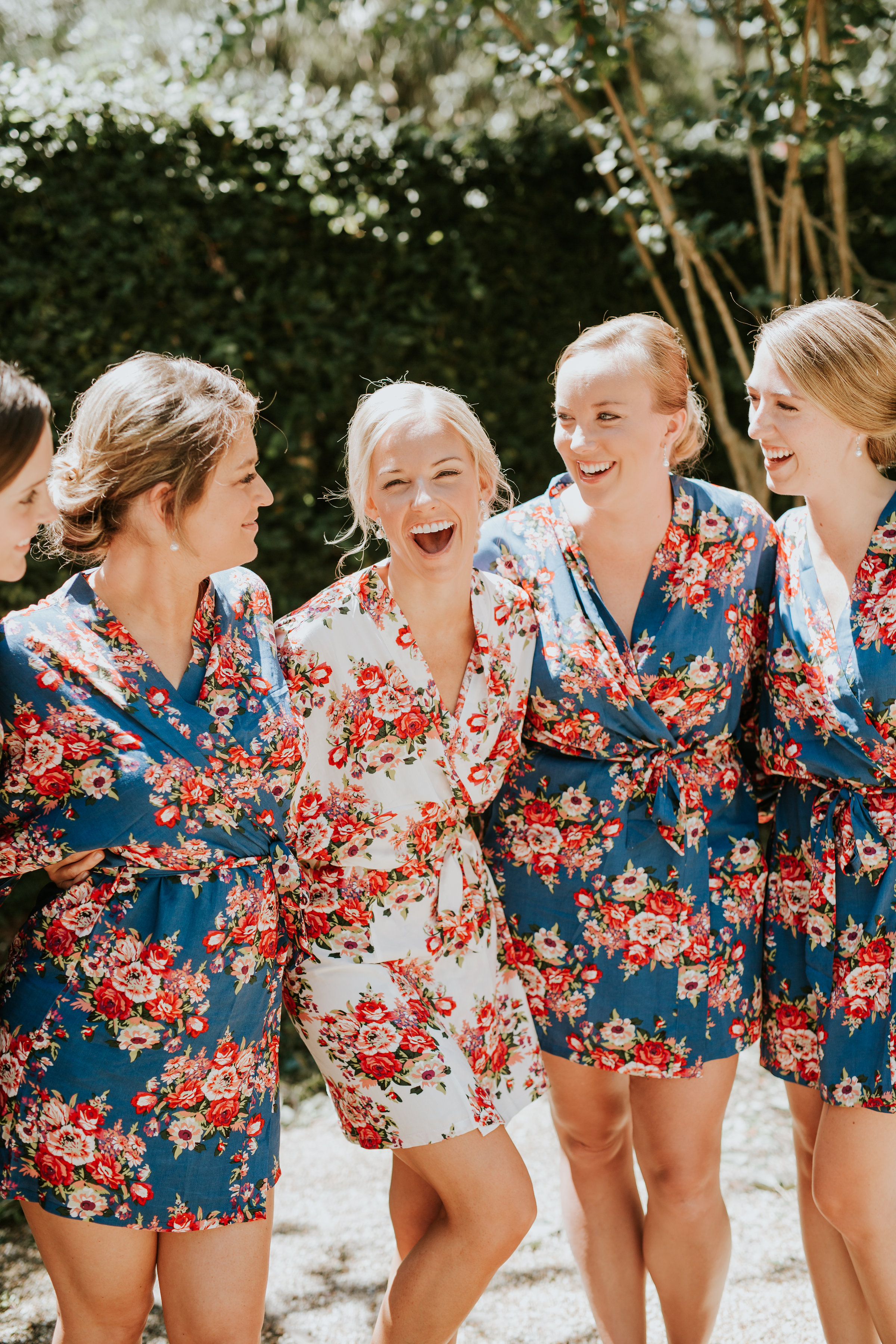 Bride and bridesmaids in floral robes for Hilton Head SC wedding