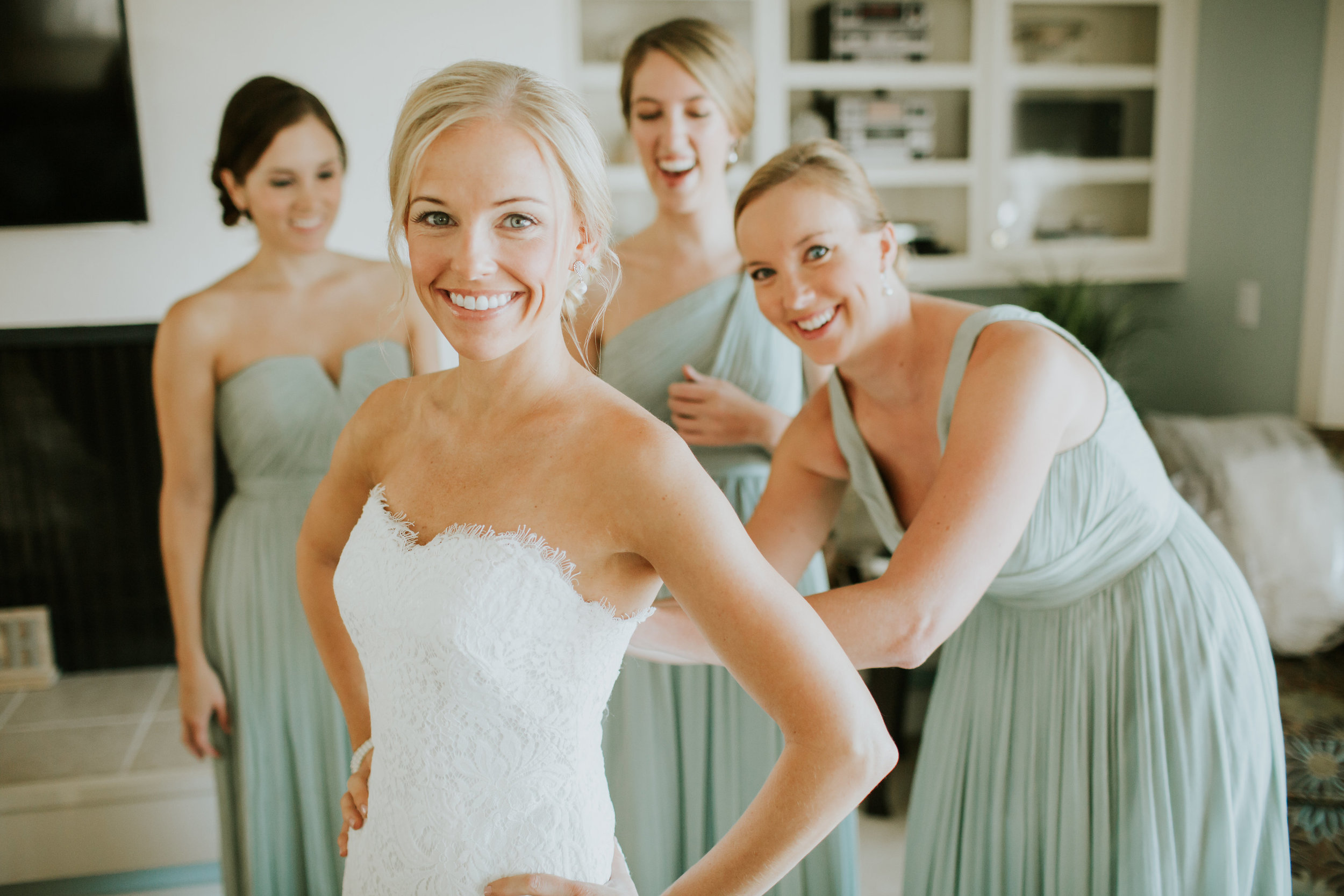 Bride stepping into her Theia lace wedding dress  //  Hilton Head SC wedding photography by Carrie Friesen