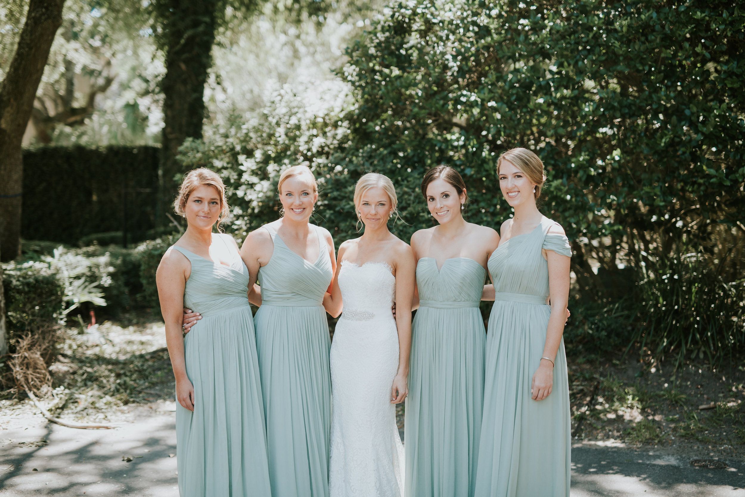 Bridesmaids in long sage J. Crew dresses  //  Hilton head wedding photography by Carrie Friesen