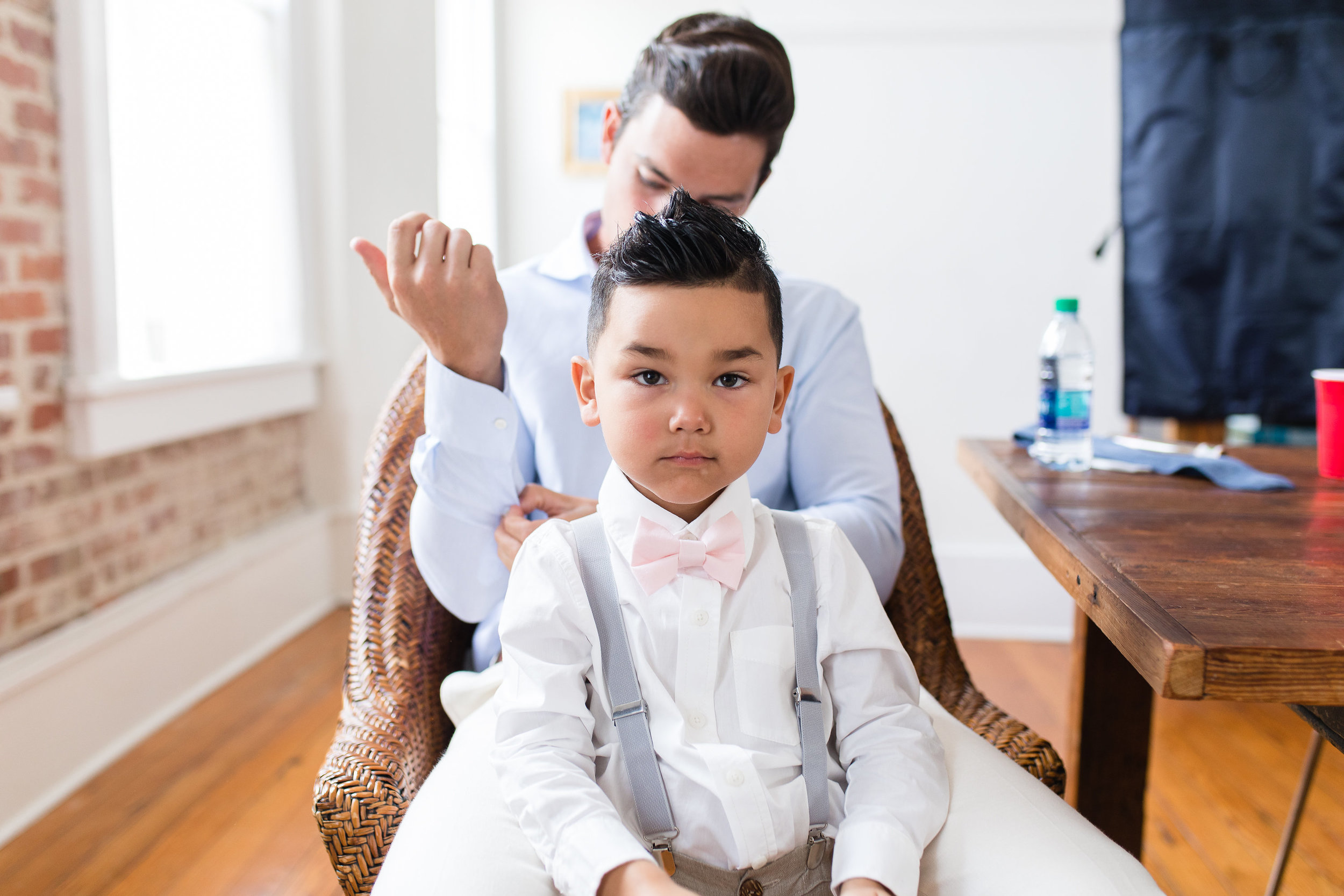 Ring bearer in pale pink bow tie and grey suspenders  //  Hilton Head wedding photos by Garter + Whiskey