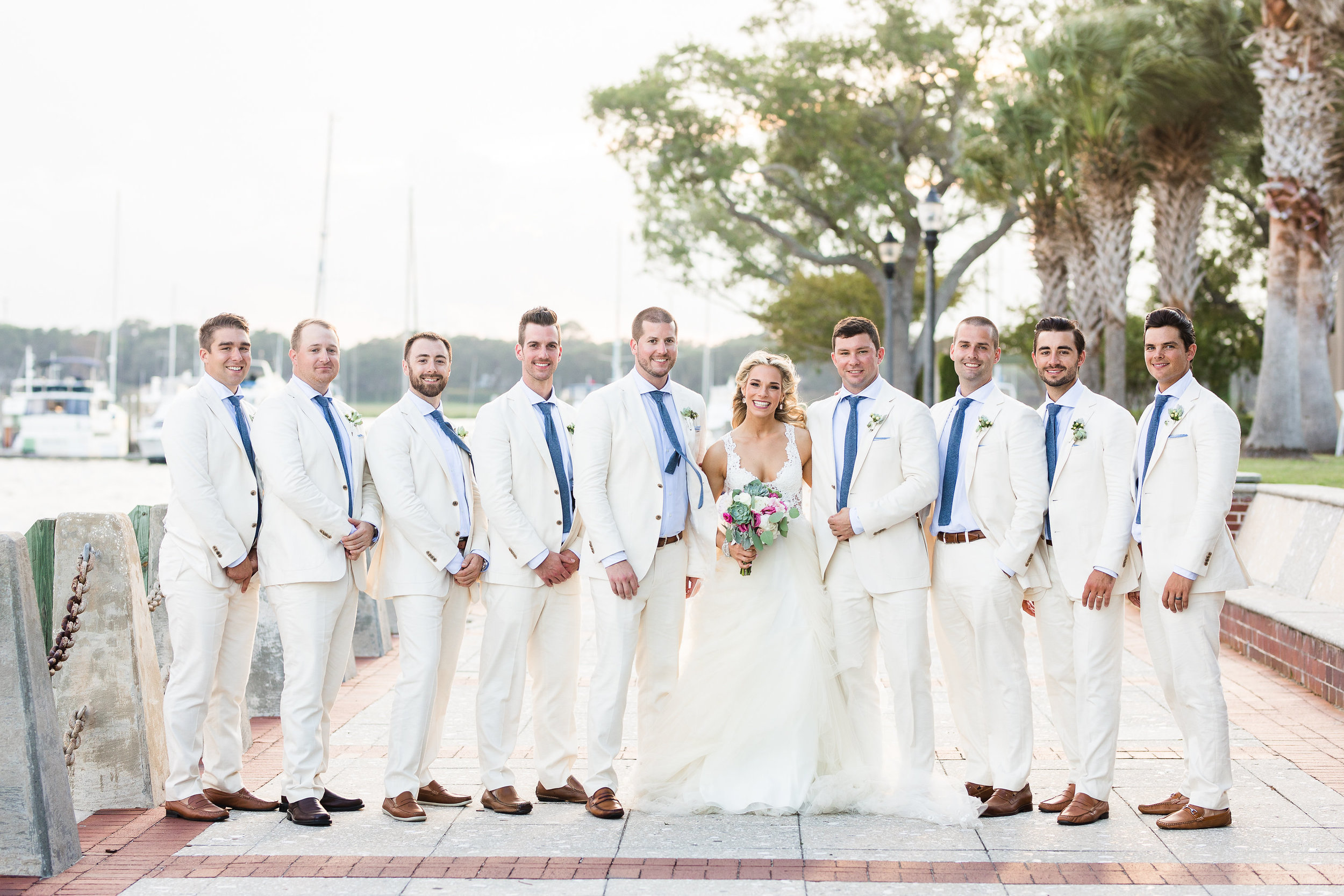 Beaufort SC groomsmen in linen suits with light blue shirts and dark blue ties  //  Hilton Head wedding photos by Garter + Whiskey  Hilton Head bride in Winnie Couture gown in Beaufort SC  //  A Lowcountry Wedding Magazine
