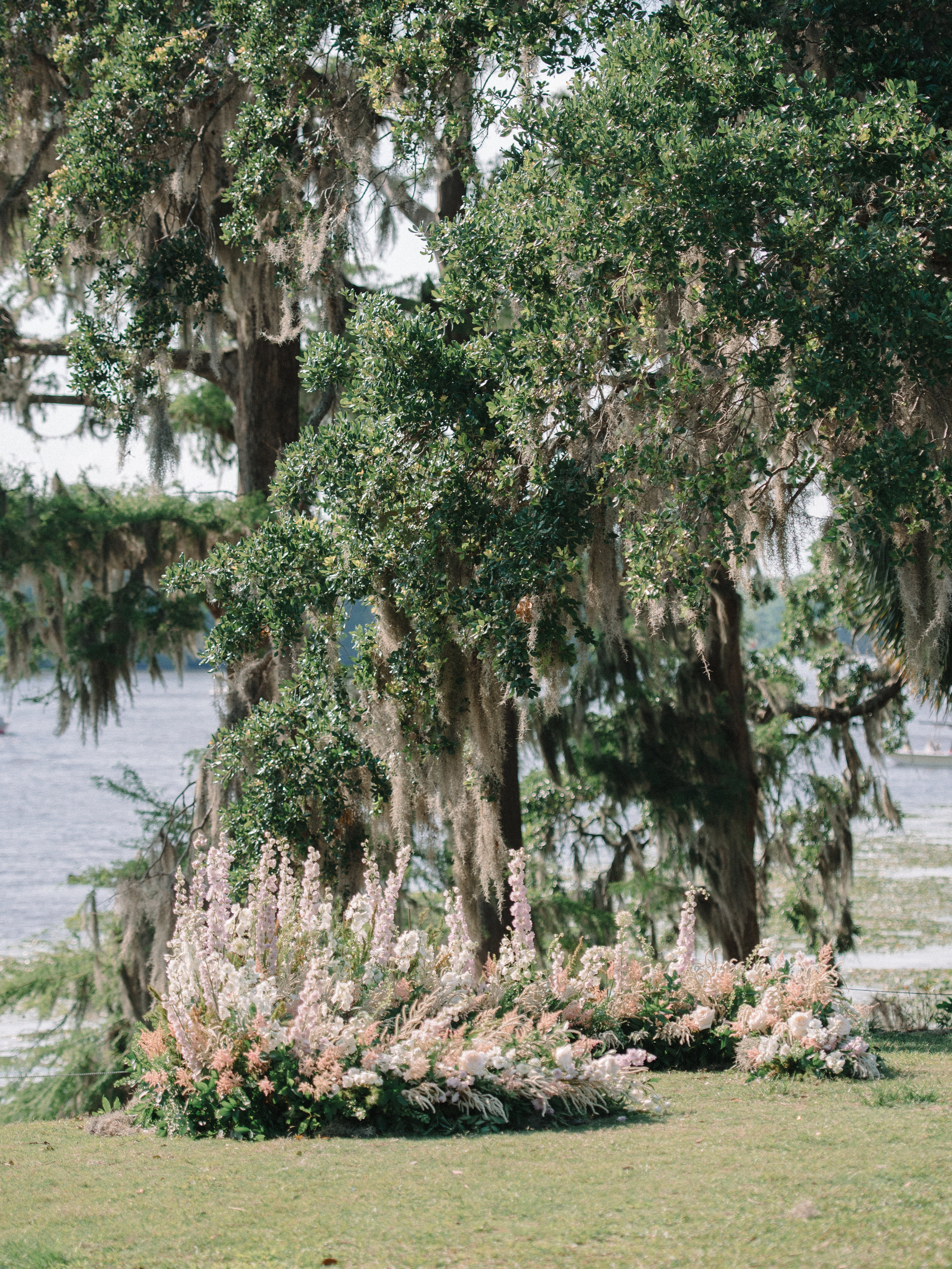 Floral ceremony horseshoe by Scarlet Begonias at Wachesaw Plantation in Murrells Inlet SC  //  Myrtle Beach wedding photos by Pasha Belman Photography