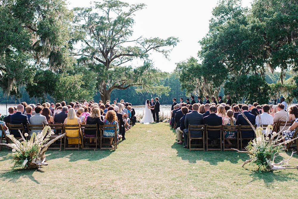 Outdoor wedding ceremony at Wachesaw Plantation in Murrells Inlet SC by Pasha Belman Photography