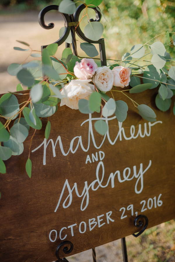 Hand-lettered wedding welcome sign at Magnolia Plantation and Gardens in Charleston SC  //  A Lowcountry Wedding Magazine