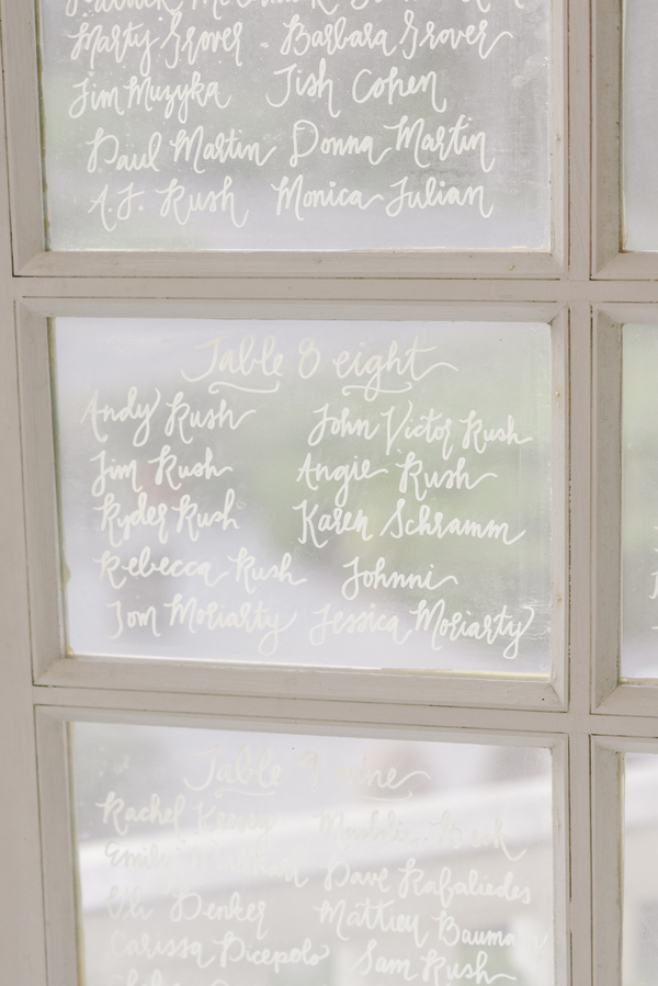 Hand lettered seating chart for wedding at Magnolia Plantation