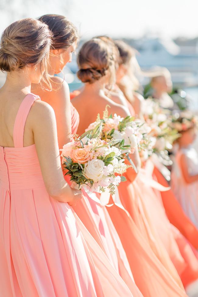 Coral Bridesmaids dress and pink peonies at Savannah wedding