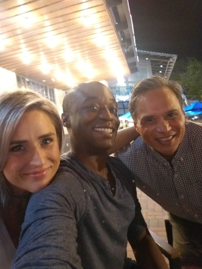 Lauren, Deandre, and Gil celebrating with a night out