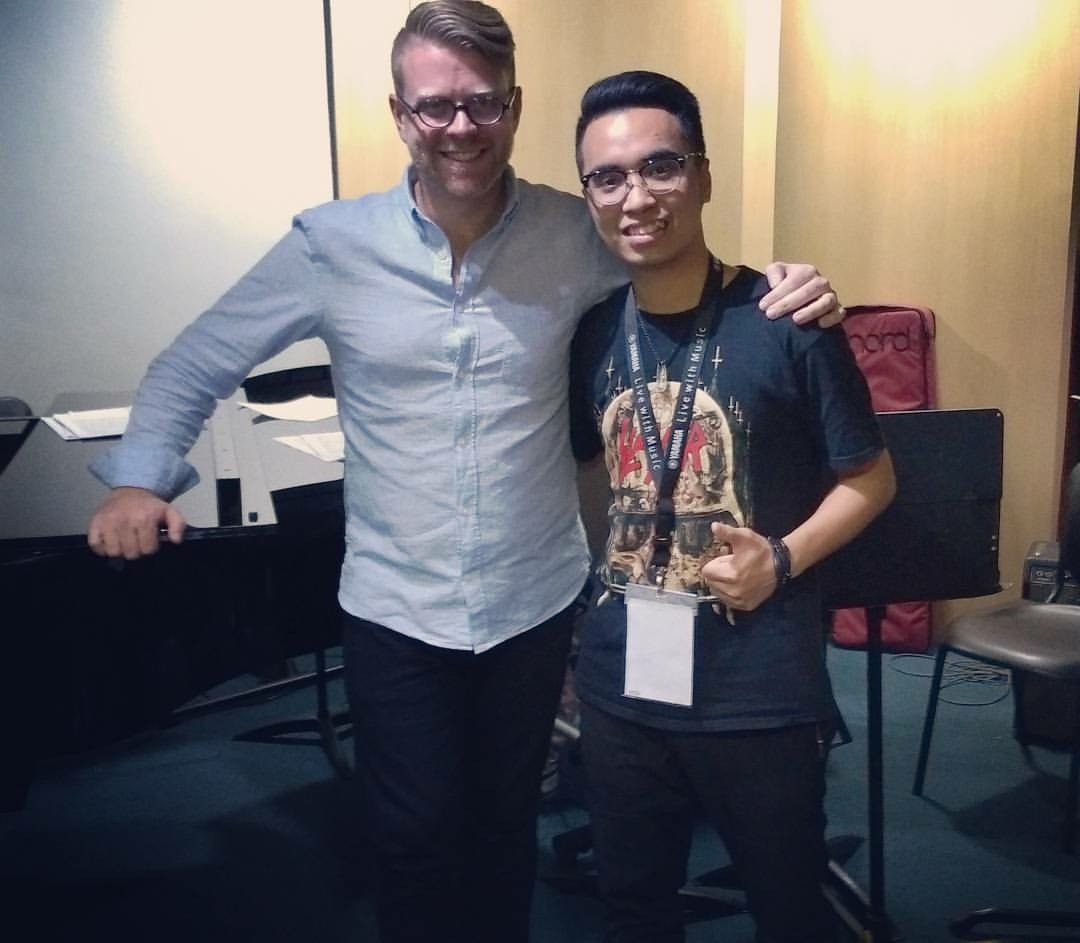 Myself and Tu, one of the students in my 13-piano Zebra Ensemble