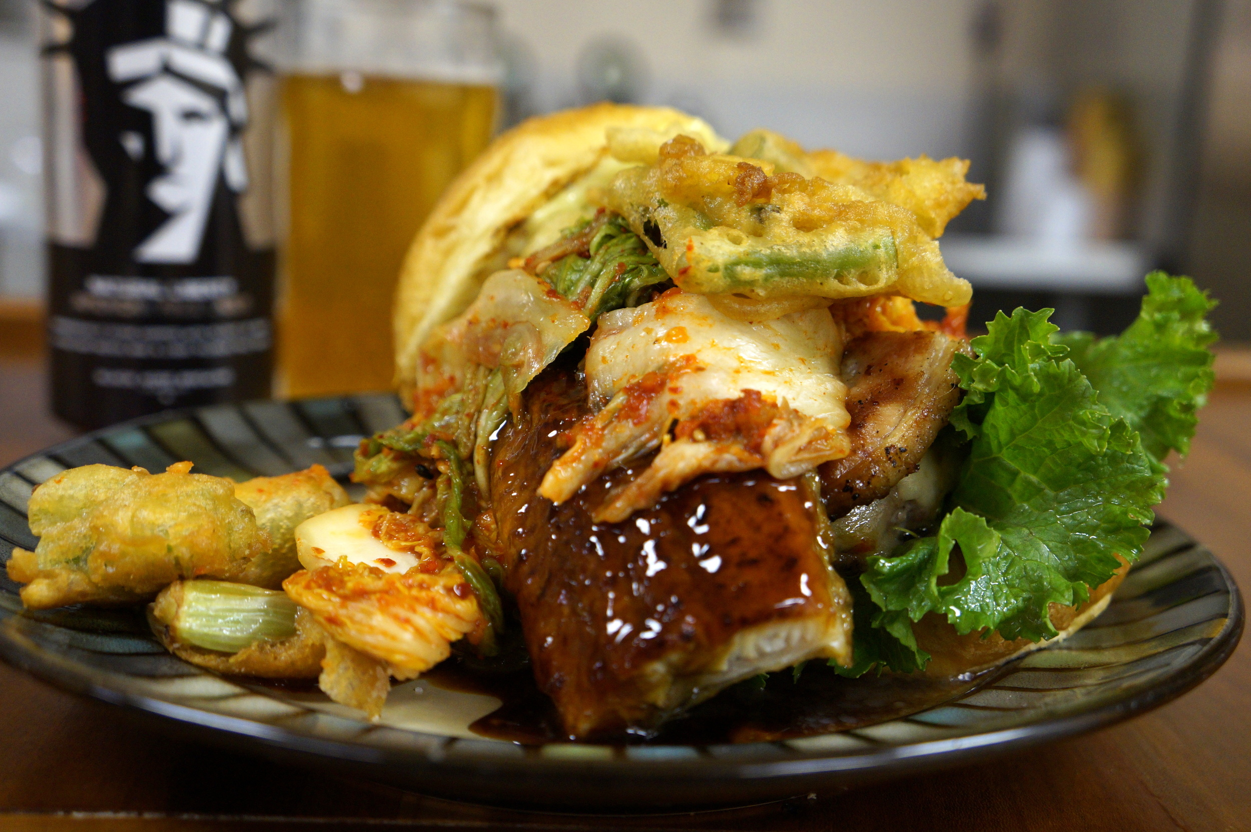 Kimchi, unagi, unagi sauce (made w/ Black Acre's Natural Liberty and Four Rose's bourbon), Fischer Farms beef patty, Love Handle's bacon, Traders Point habanero cheddar, Sriracha, Wasabi mayo and topped with beer-battered green onions.