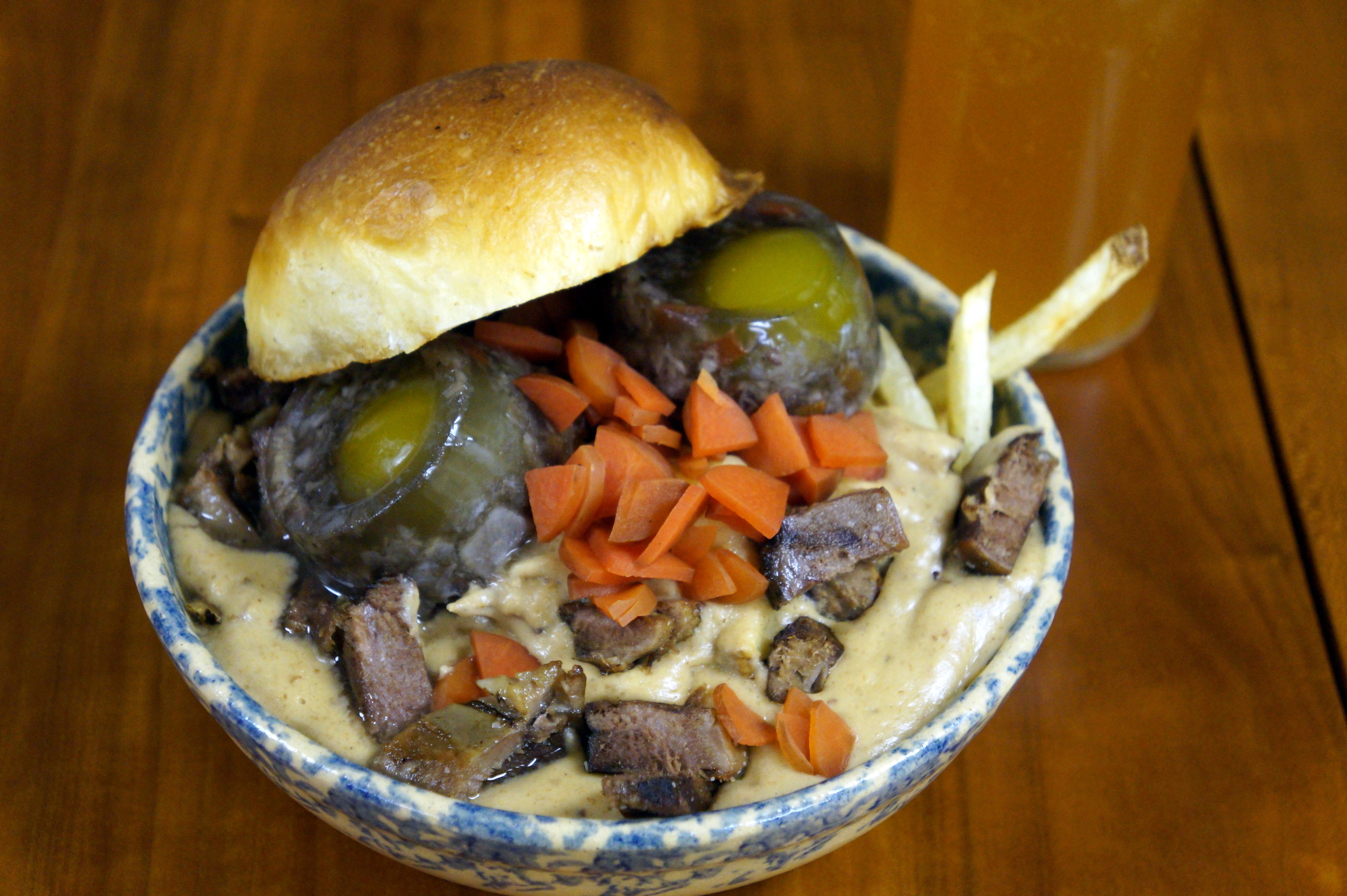Hand-cut fries, Fischer Farms beef patty, Love Handle's beef tongue and mushroom gravy, Wisconsin cheese curds, Love Handle's jellied eggs, bacon and pickled carrots.