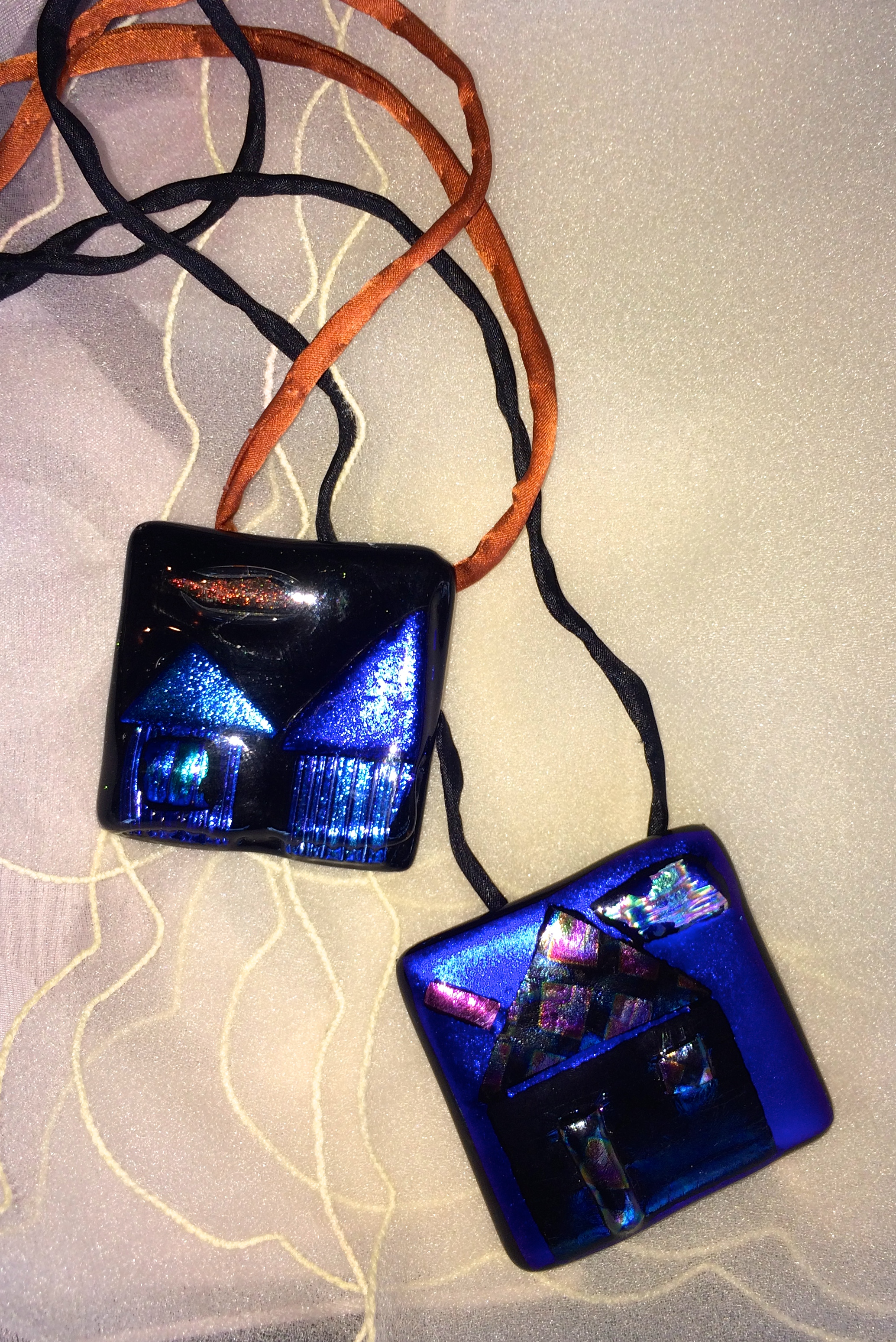Claire enjoys donating work to charitable causes and supports homeless children with the sales of her glass house pendants.
