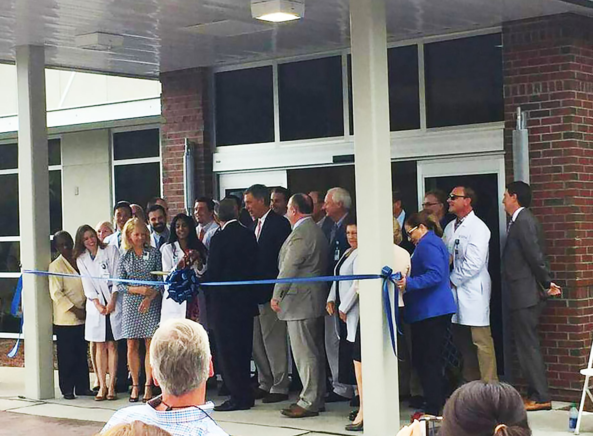 Ribbon Cutting - wide shot hi-res.jpg