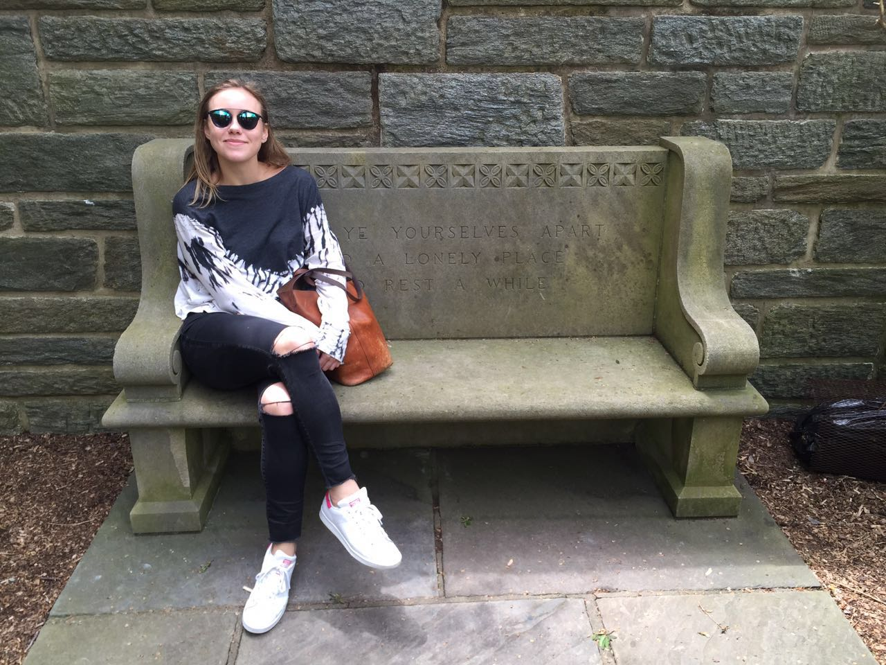 Julia's favorite spot on campus. She says she spent many afternoons reading on this bench in the secret garden behind the chapel!