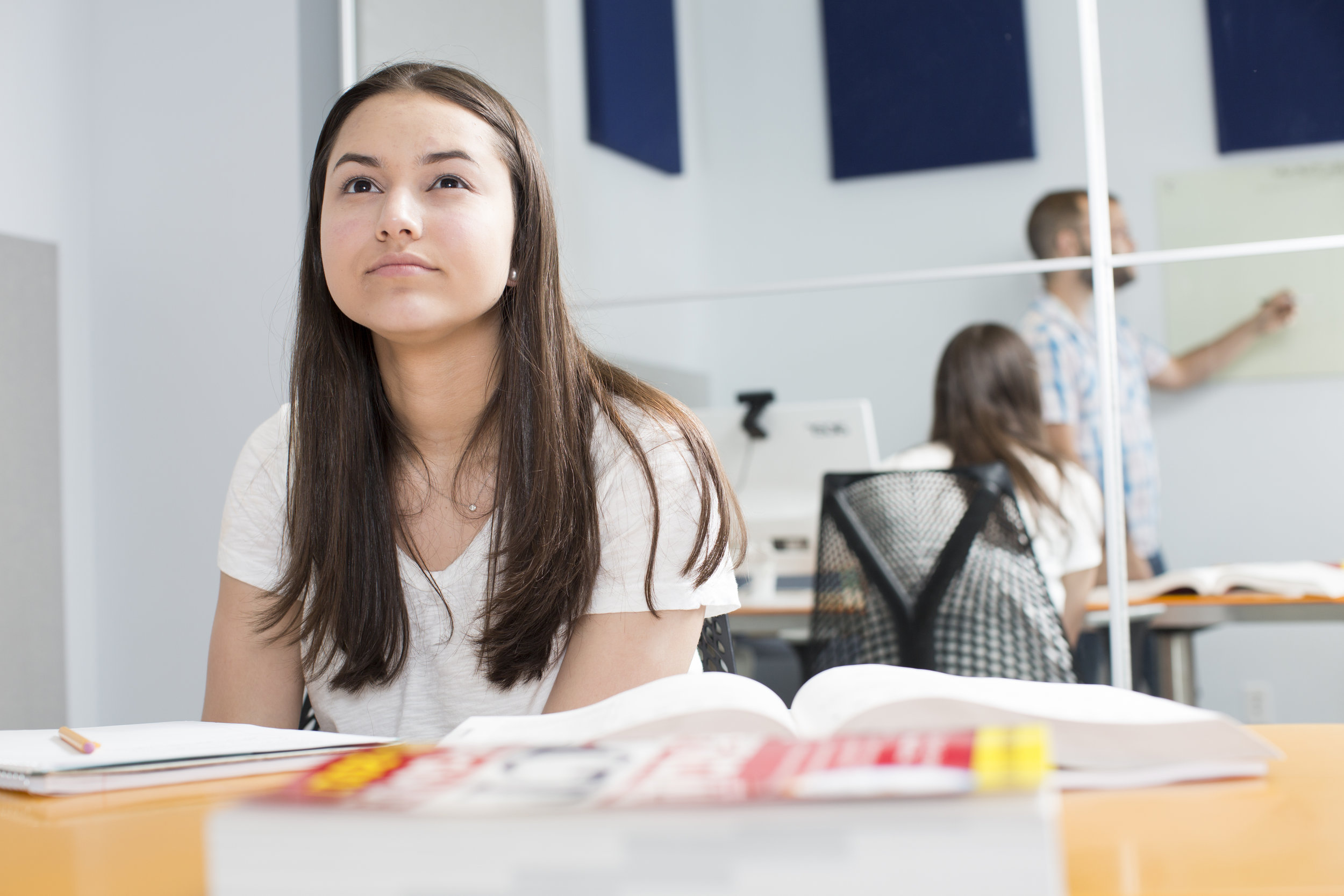 Female student listening to lesson 3.jpg