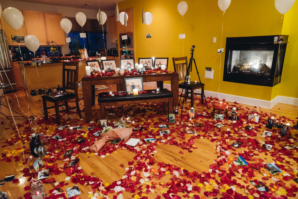 Rose petals, tea lights, balloons and pictures of us were littered all over.