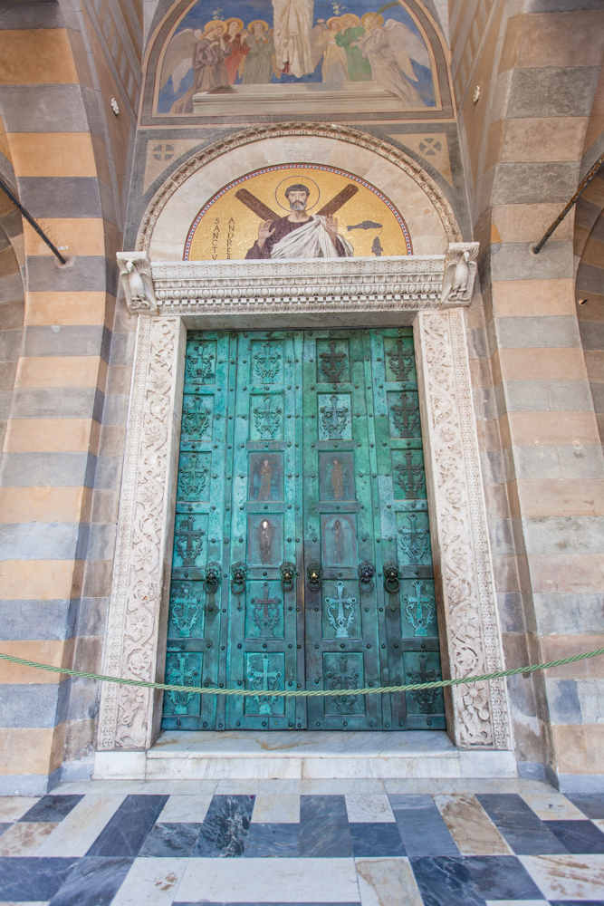 These set of magnificent bronze doors feature four figures in the center; Christ and Virgin Mary at the top, St. Andrew and St. Peter below.