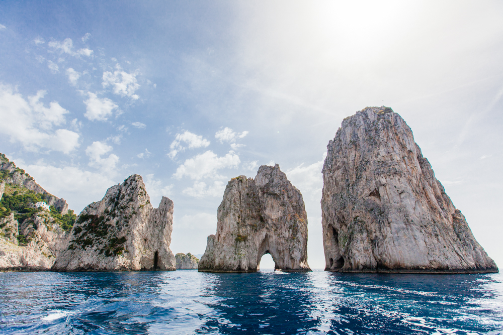 Faraglioni; these oceanic rock formations have been eroded away by the ocean waves.  It is said to bring good luck if you kiss your love under the arch in the center rock.  Good thing our tour guide was experienced, the waves were somewhat choppy and the arch was small!