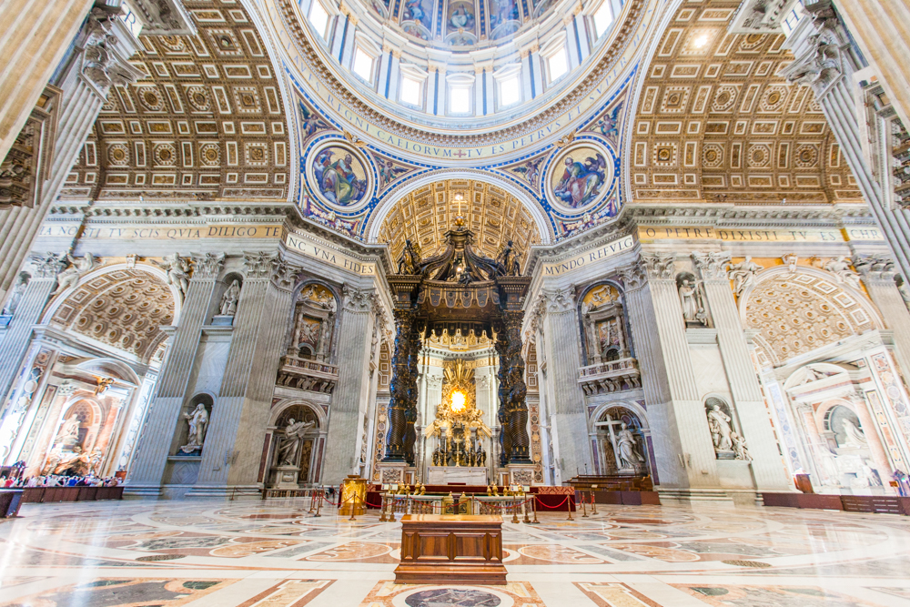 The altar with the baldacchino; a 98 ft tall structure that is claimed to be the largest bronze piece in the world.  The baldacchino serves as a holy space above and around the table on which the Sacrament is laid for the Eucharist.