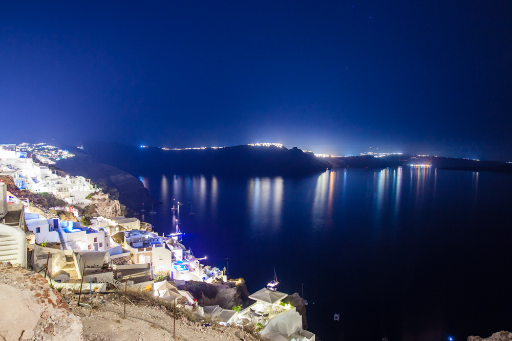 in the distance, you can see Fira (another town in Santorini) lit up at night. In a future blog post, I will document our hike from Fira back to Oia.