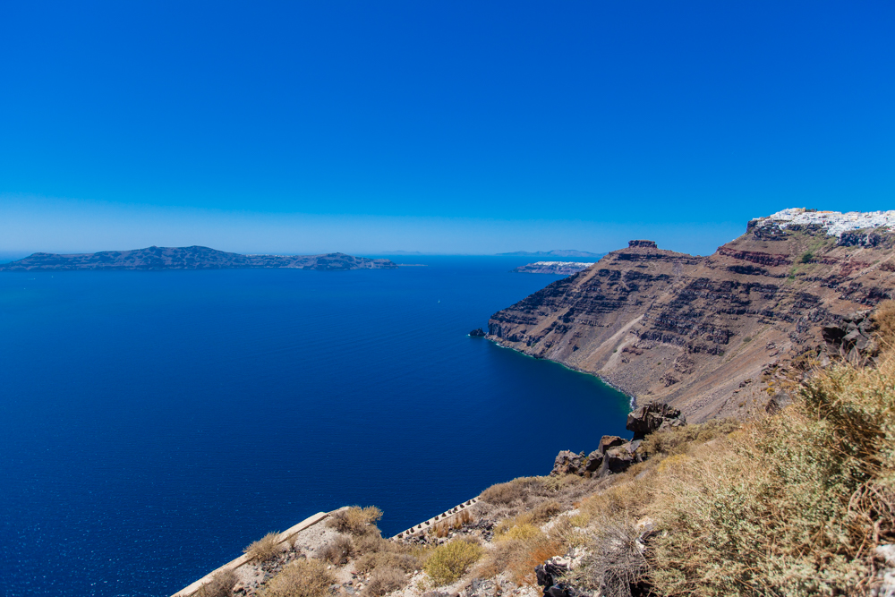 The panoramic views are spectacular!  If you look closely, you can see Oia at the very end of the caldera.