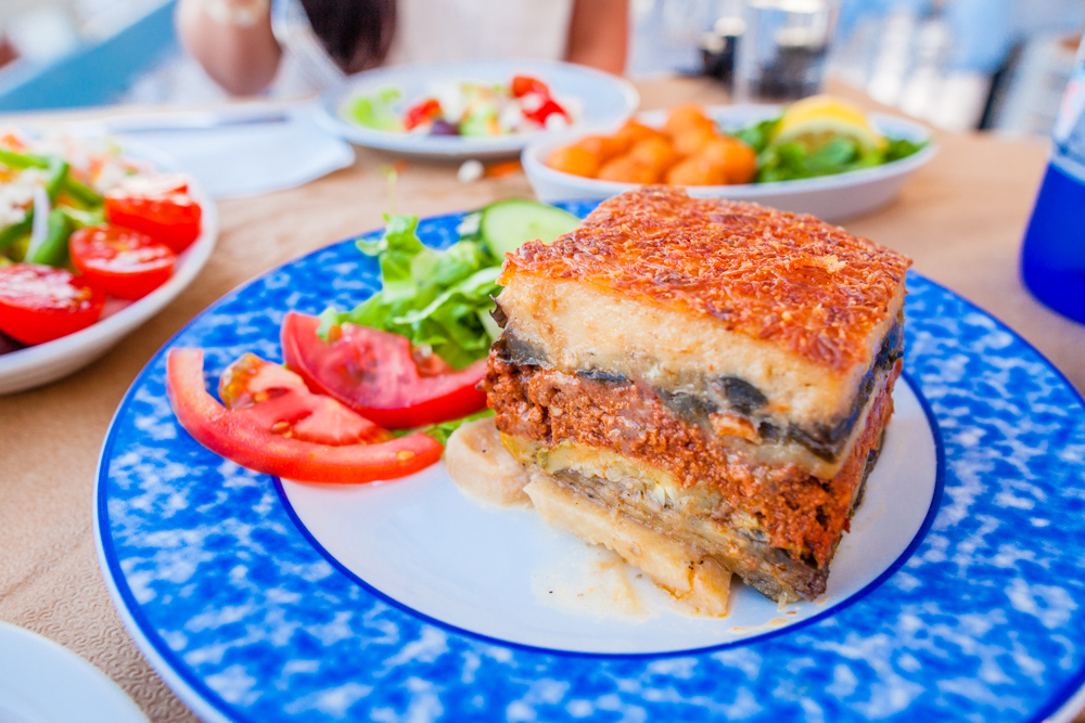 Moussaka; an eggplant and potato-based dish with minced meat, cheese, and a bechamel sauce that is layered like a casserole; very good