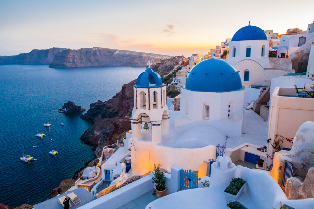"Santorini has some of the best sunsets in the world.  There is a specific point where people ""camp out"" waiting several hours for the sunset.  But, I found that if you explore the alleys, you'll find an even better view that's not nearly as crowded."