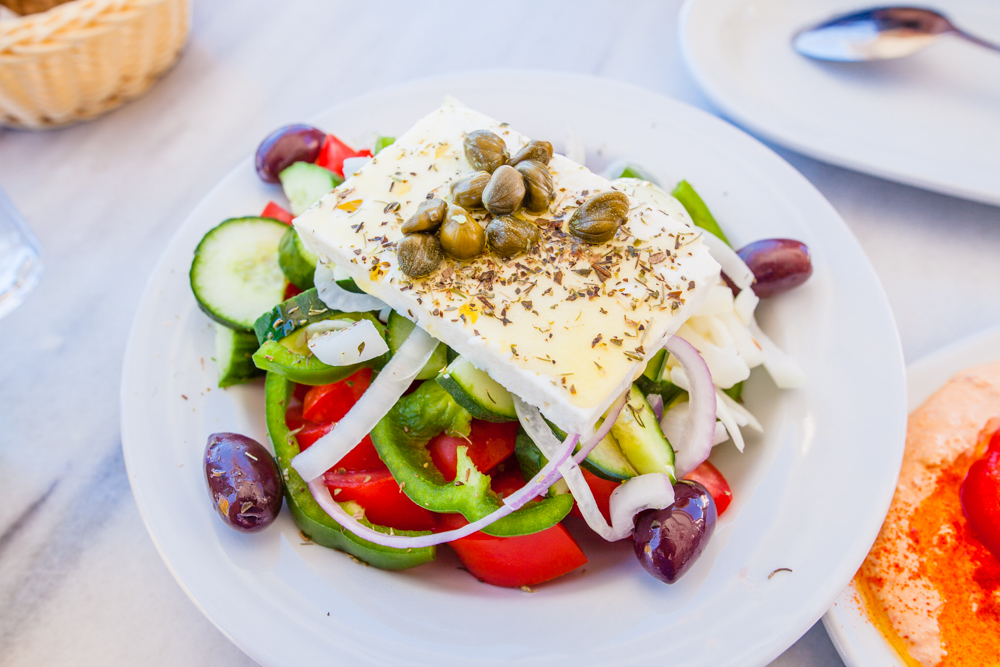 Greek salad (red and green bell peppers, onions, black olives, feta cheese, capers, and olive oil/spices)