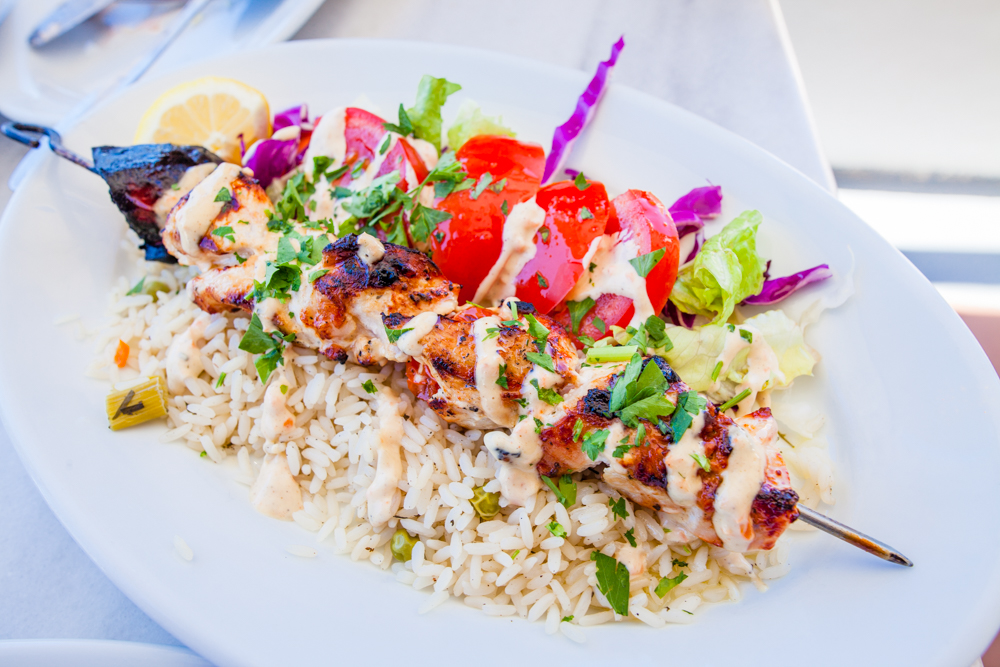 Chicken kabob over rice