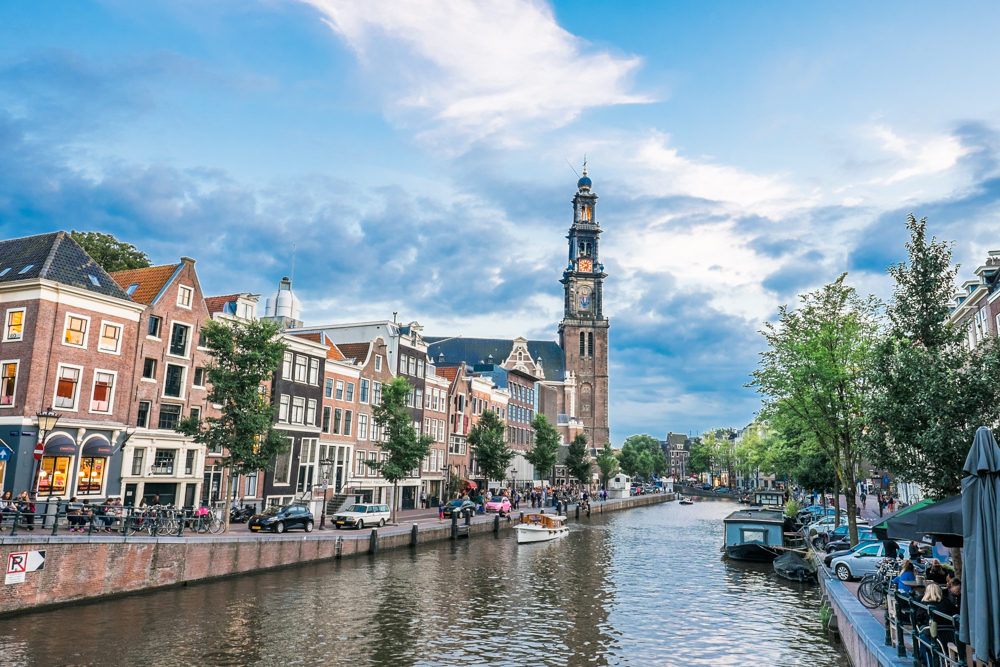 Next to the tall church, on the left, is Anne Frank's House. For more than two years, Anne Frank and her family hid in the secret annex behind the bookcase. They were isolated from the world in complete darkness; unable to enjoy this view, uncertain of what their future held.