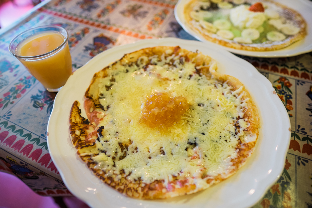 Dutch pancakes are very thin, almost crepe-like. This is a savory one;the bacon, cheese, and ginger pancake.