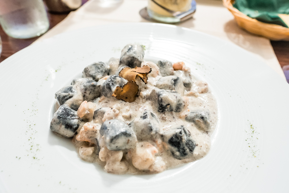"Gnocchi ""Istria""; black gnocchi with black truffle and shrimp in a creamy wine sauce. I would like to re-name this dish ""pillows from heaven."" It's one dish that I dream and reminisce about often; one reason alone why I would travel back to Croatia."